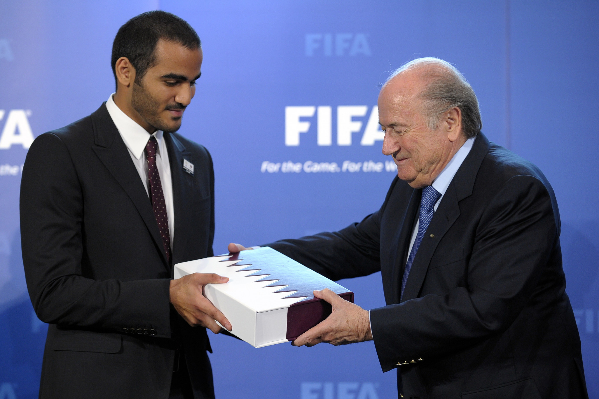 Chairman of Qatar 2022 bid committee Sheik Mohammed bin Hamad Al Thani delivers the bid book to FIFA President Sepp Blatter during an official handover ceremony at FIFA's headquarters in May 2010 in Zurich ©Getty Images