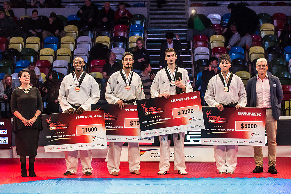 The podium also included Britain's Mahama Cho, left, who lost in the semi-finals to Aiukaev, third from left ©World Taekwondo