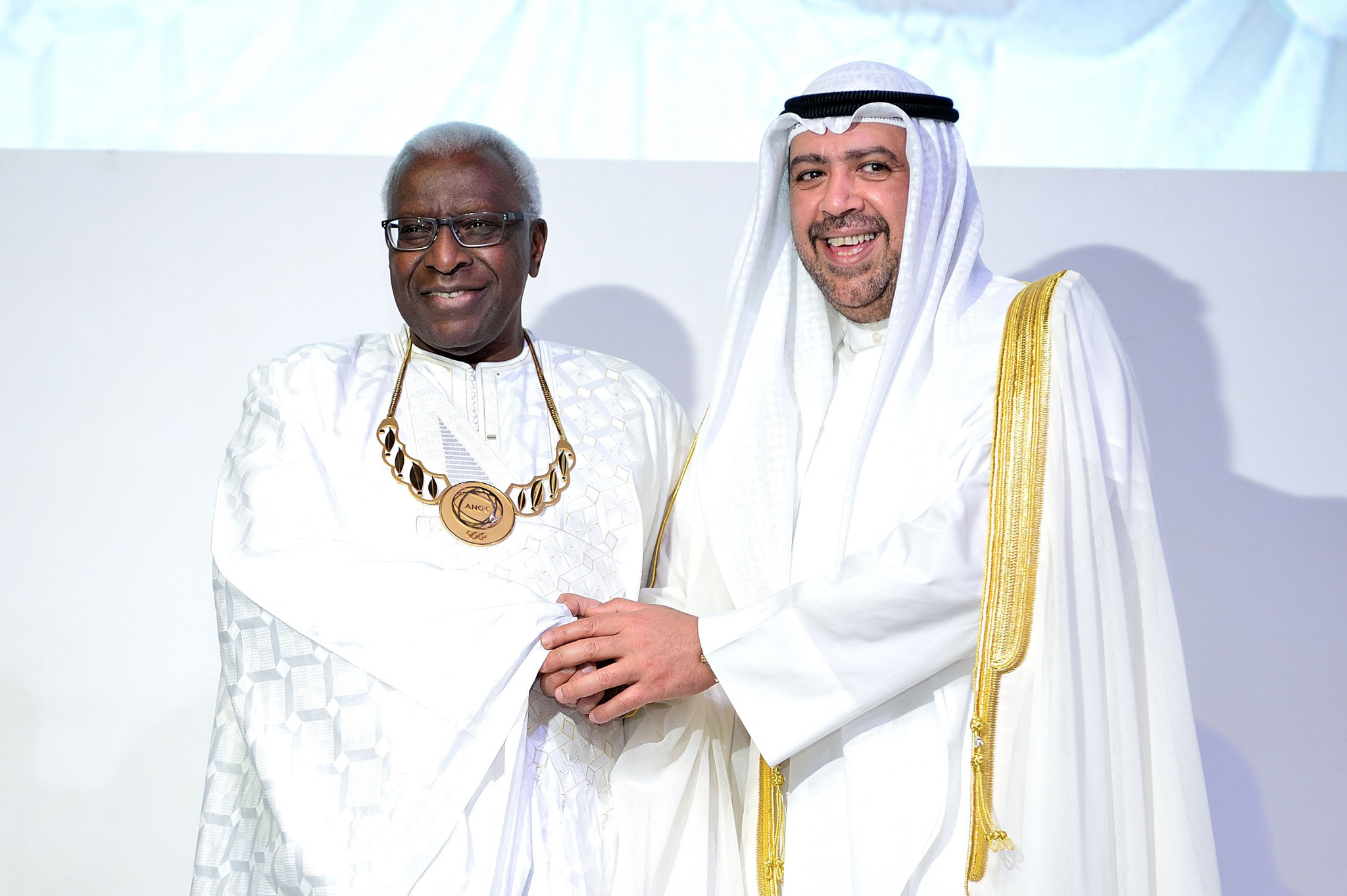 Lamine Diack, left, pictured with Sheikh Ahmad at the 2014 ANOC General Assembly in Bangkok ©Getty Images