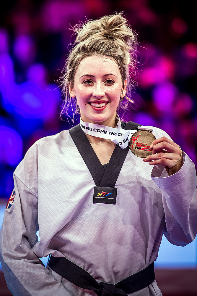 The 24-year-old shows off her gold medal ©World Taekwondo