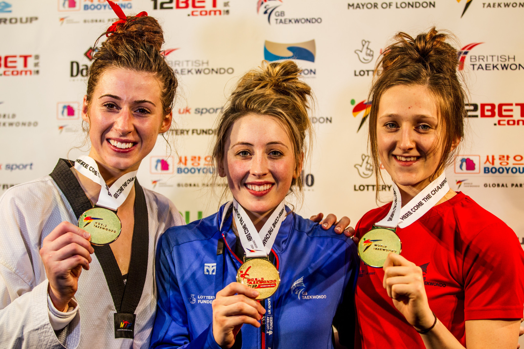 Bianca Walkden, left, and Jade Jones, centre, both won gold medals today at the World Taekwondo Grand Prix series event in London, increasing hosts Great Britain's gold medal tally to three after success for Lauren Williams, right, yesterday ©GB Taekwondo