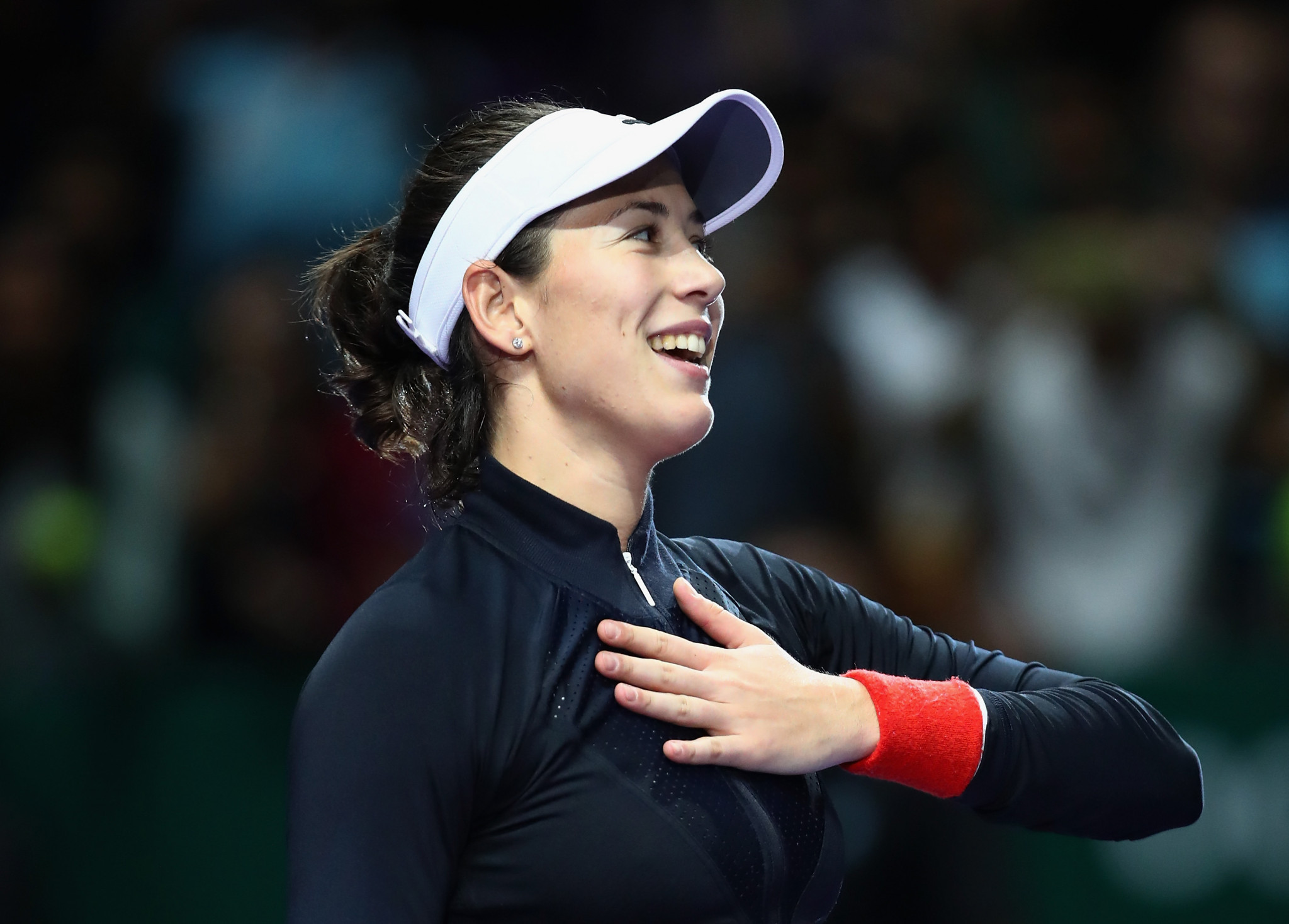 Muguruza and Pliskova victorious on day one of WTA Finals