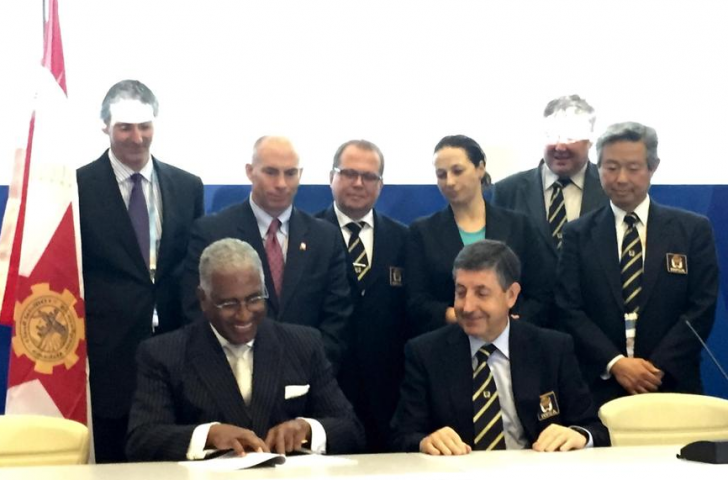 Officials from Birmingham, Alabama, sign the official ratification that they will host the 2021 World Games at the end the International World Games Association General Assembly in Sochi today