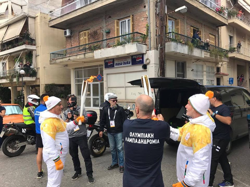 Composer Yiannis Psimadas, right, carries the Pyeongchang 2018 Torch on its journey towards Athens ©HOC