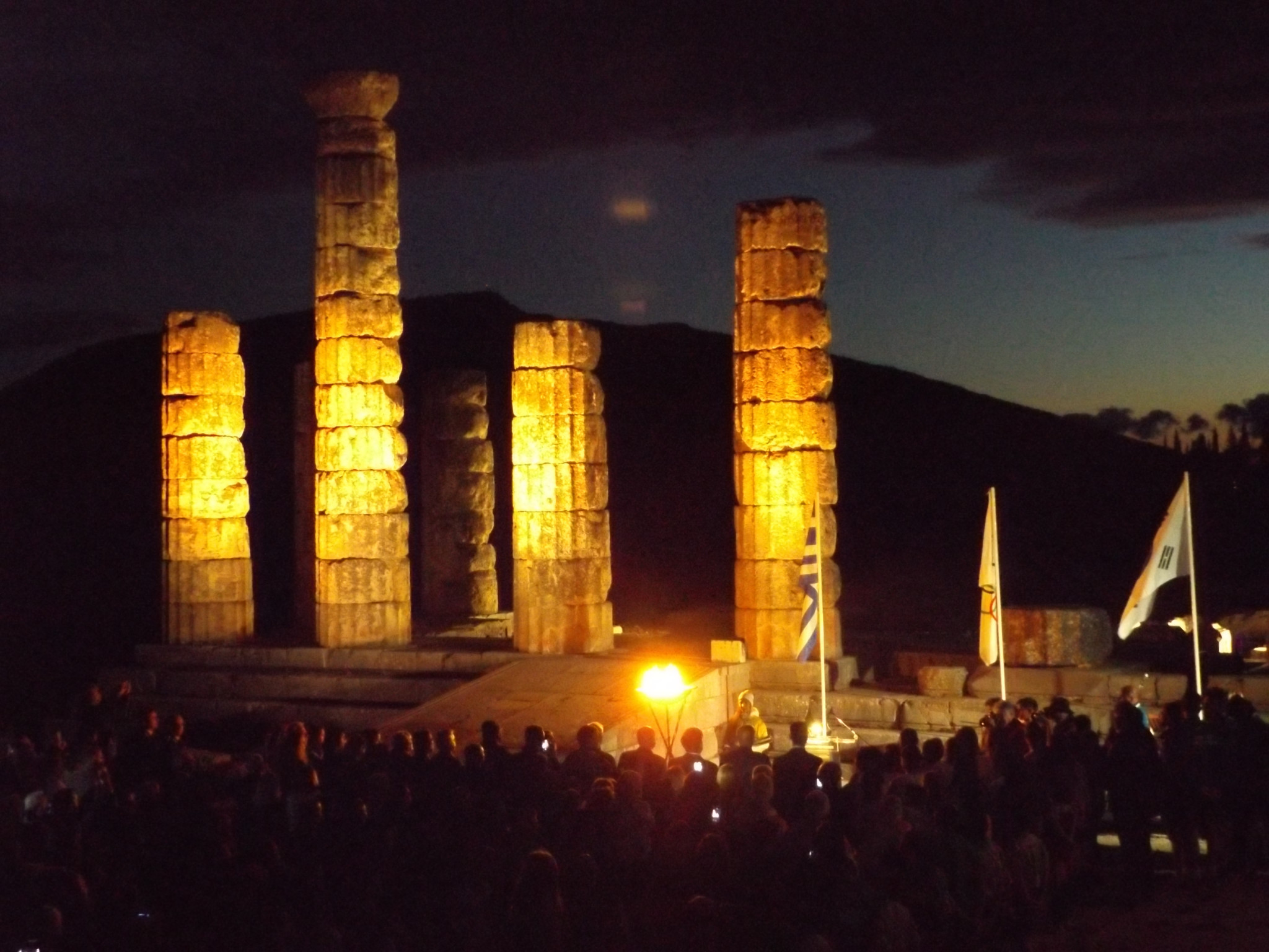 The Olympic flame against the backdrop of the temple of Apollo in Delphi ©ITG