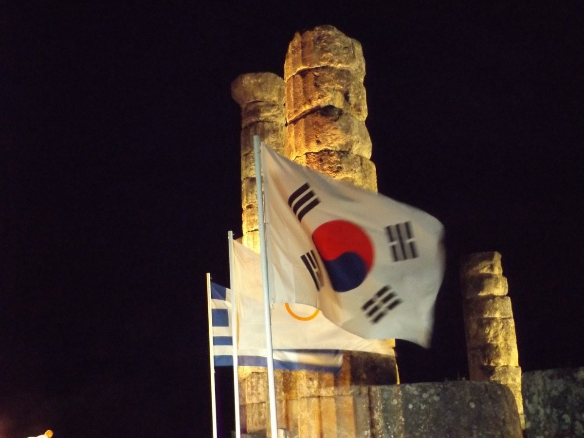 The South Korean flag flew alongside those of Greece and the International Olympic Committee in Delphi ©ITG