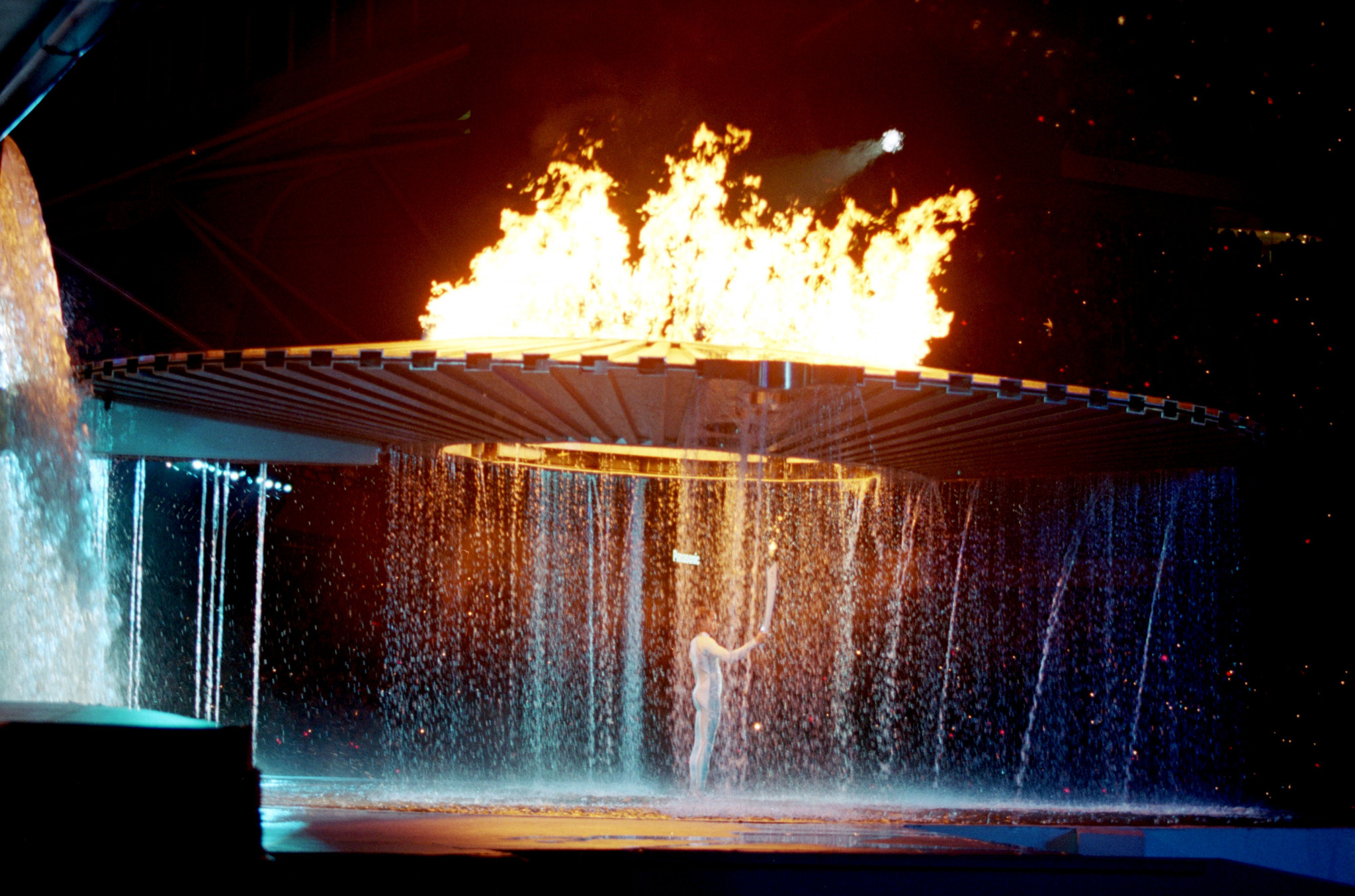 Cathy Freeman of Australia lights the Olympic Flame during the Opening Ceremony of the Sydney 2000 Olympic Games at the Olympic Stadium in Homebush Bay, Sydney, Australia.©Getty Images