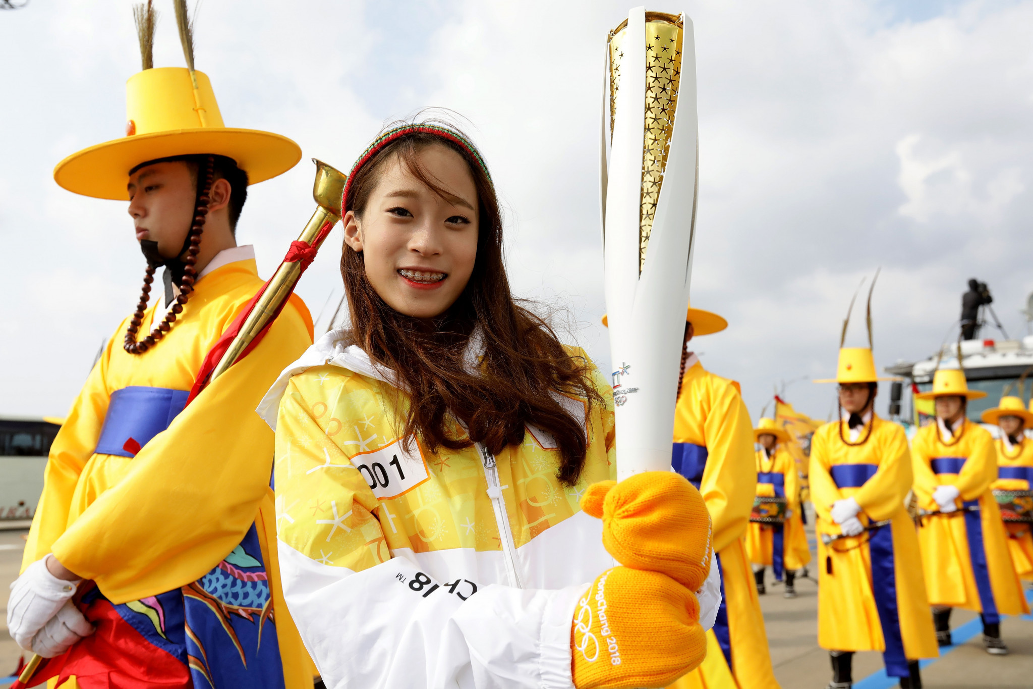 Olympic flame touches down in South Korea amid a blaze of ...
