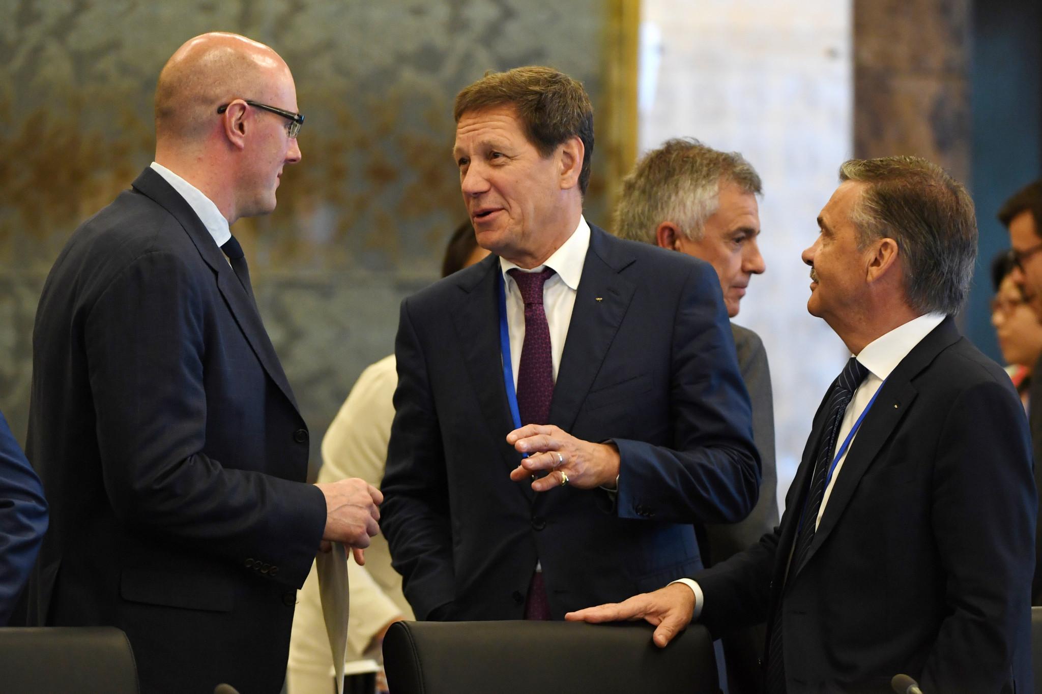 KHL President Dmitry Chernyshenko, left, alongside Alexander Zhukov, centre, and René Fasel ©Getty Images