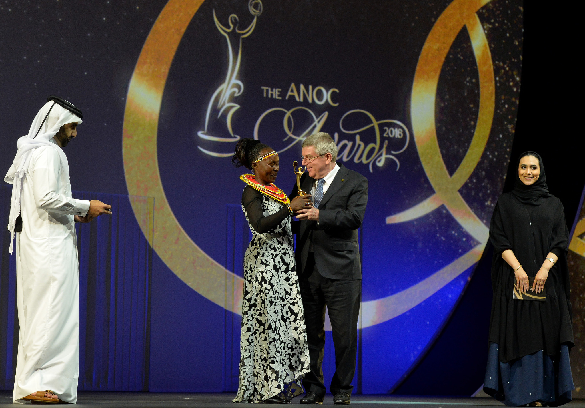 Tegla Loroupe, left, pictured with IOC President Thomas Bach during the 2016 ANOC Gala Awards in Doha ©Getty Images