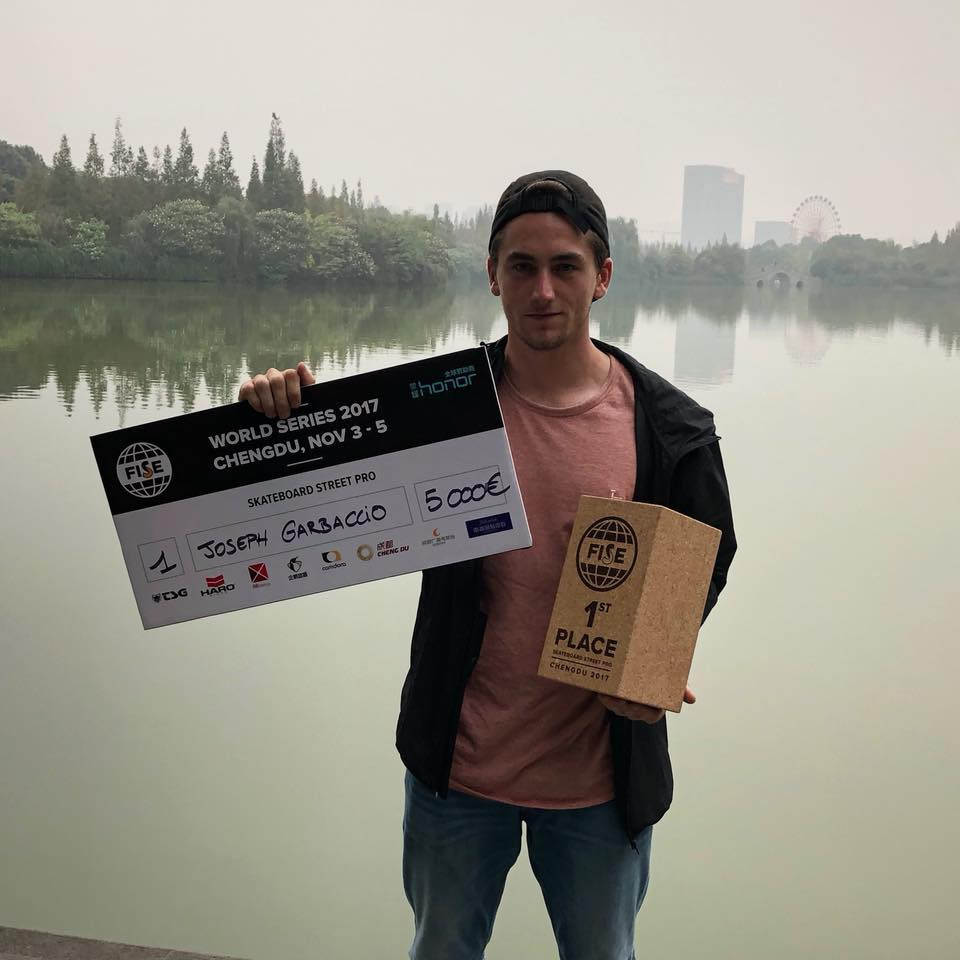 Joseph Garbaccio pictured with his winners' cheque after collecting the the FISE Skateboard Street Pro competition in Chengdu, China ©Facebook