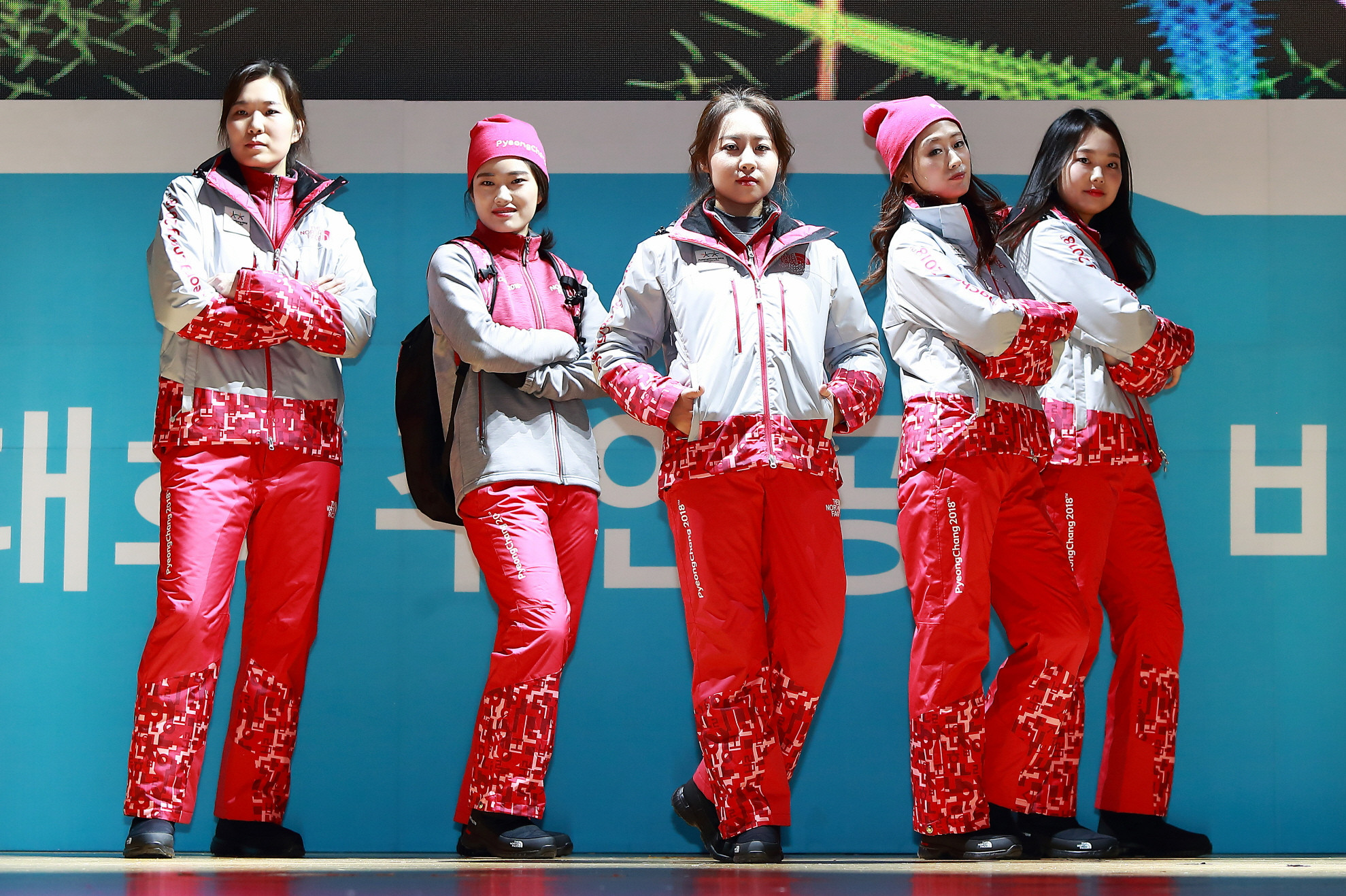 The Passion Crew show off their festive uniforms after the unveiling in Seoul of a festive red outfit that also represents the national flag ©Pyeongchang2018