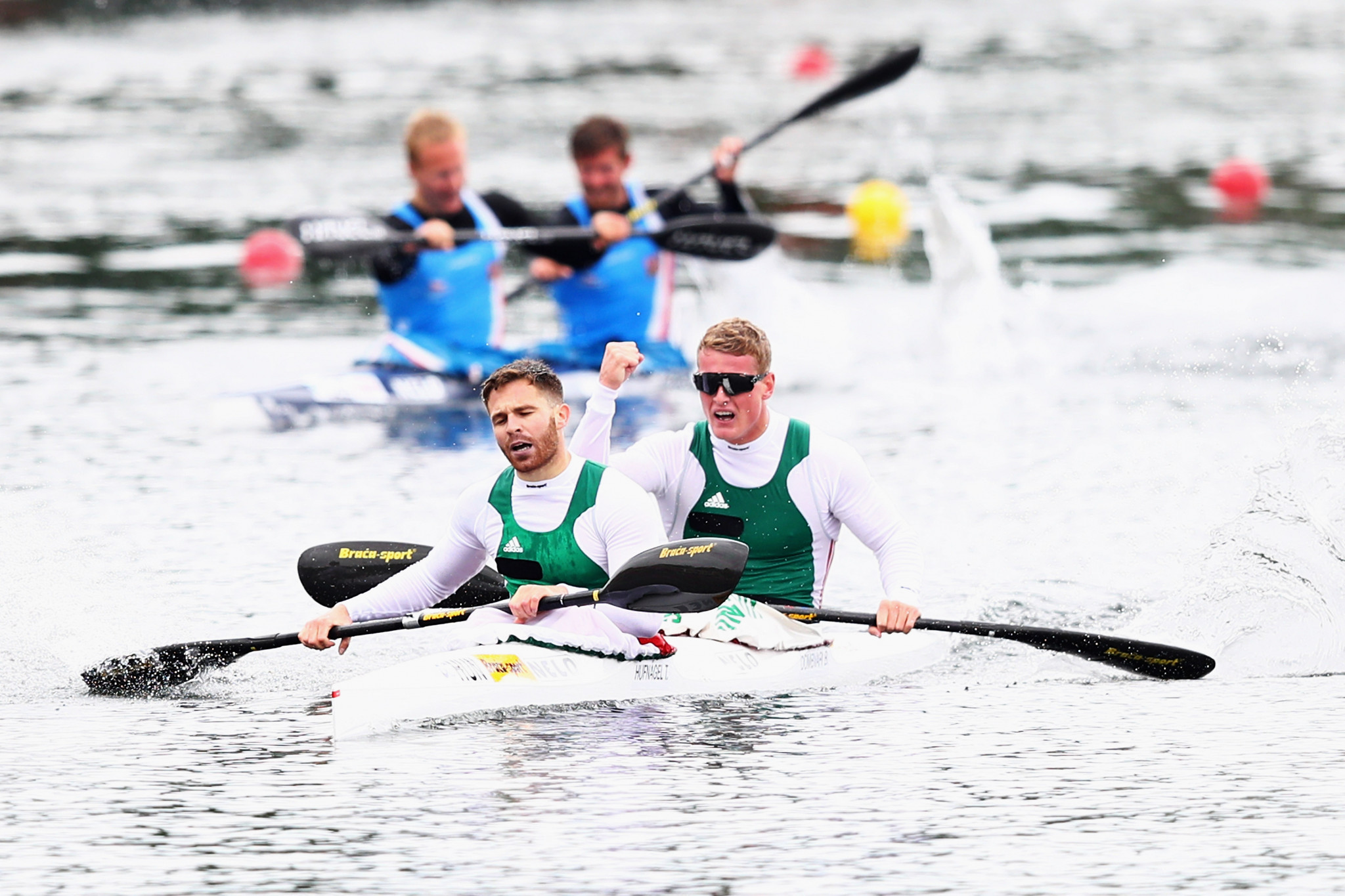 Bence Dombvari, right, and Tibor Hufnagel, of Hungary, celebrate after they compete in the K2 M 1000 during Day 2 of the European Canoe Sprint Olympic Qualifying held at Sportpark Regattabahn in May 2016 in Duisburg ©Getty Images
