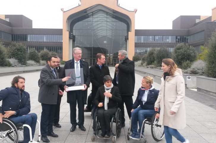 IPC President Andrew Parsons with Paris 2024 team members this morning at the cinema complex that will form the centre of the Athletes' Village at the Games ©ITG