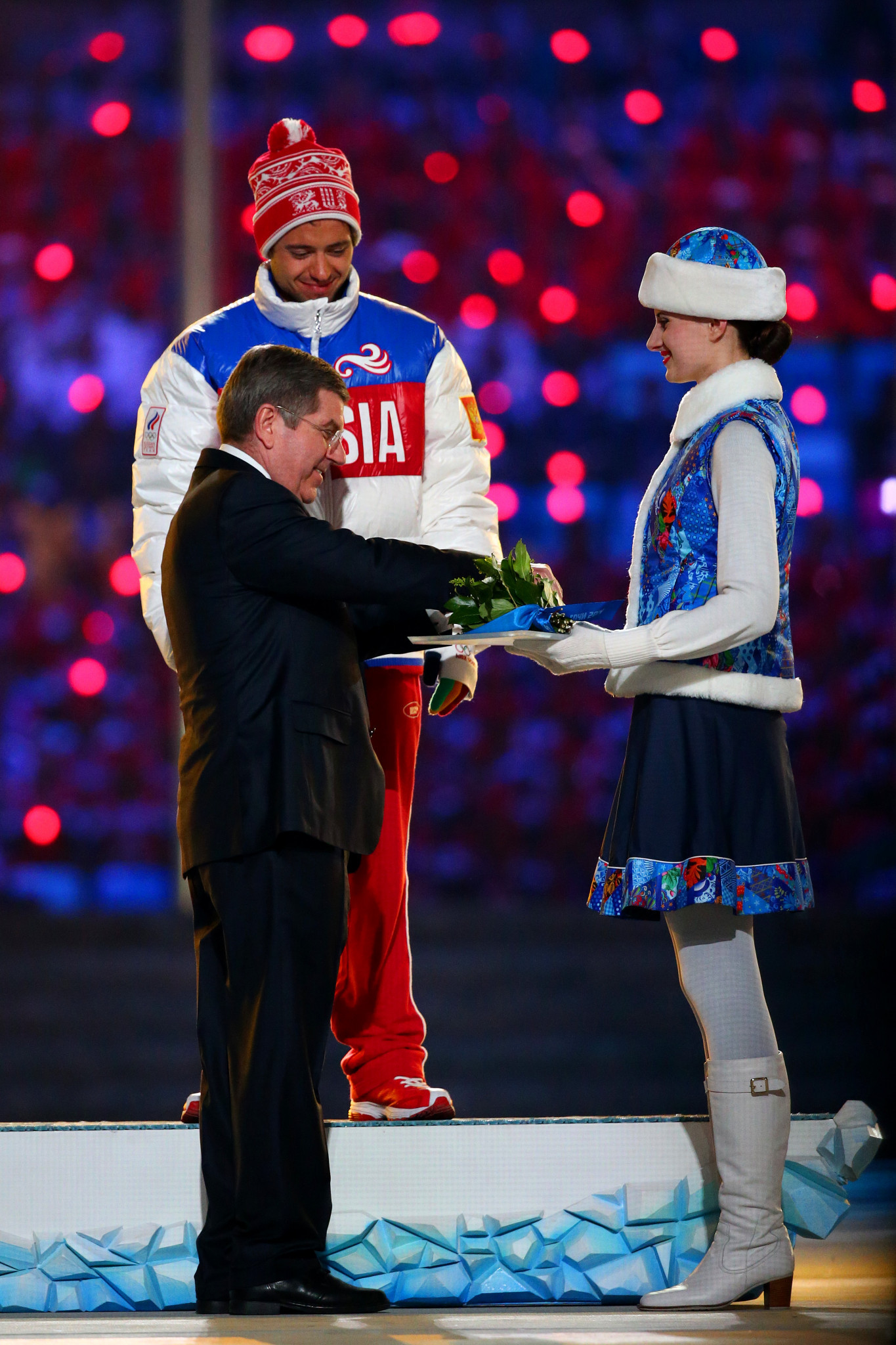 Ilia Chernousov receives his Olympic bronze medal in the 50km mass start cross-country event from IOC President Thomas Bach during the Closing Ceremony of Sochi 2014 ©Getty Images