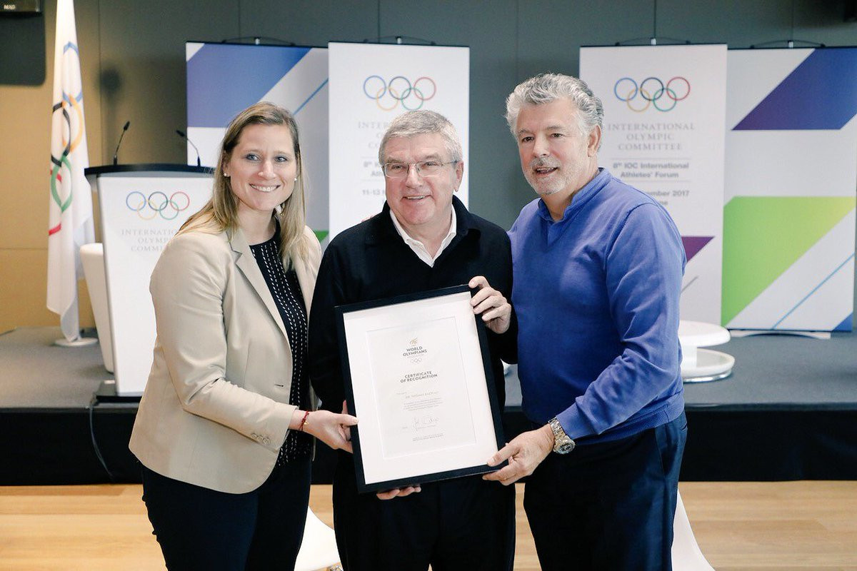 Angela Ruggiero, left, Thomas Bach, centre, and Joël Bouzou, right, are pictured at the International Athletes' Forum ©WOA
