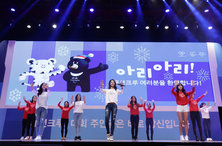Volunteers for the Pyeongchang 2018 showing off the newly designed uniforms - IPC President Andrew Parsons hopes ticket sales for the Paralympic Games will soon begin to have a similar impact ©Getty Images