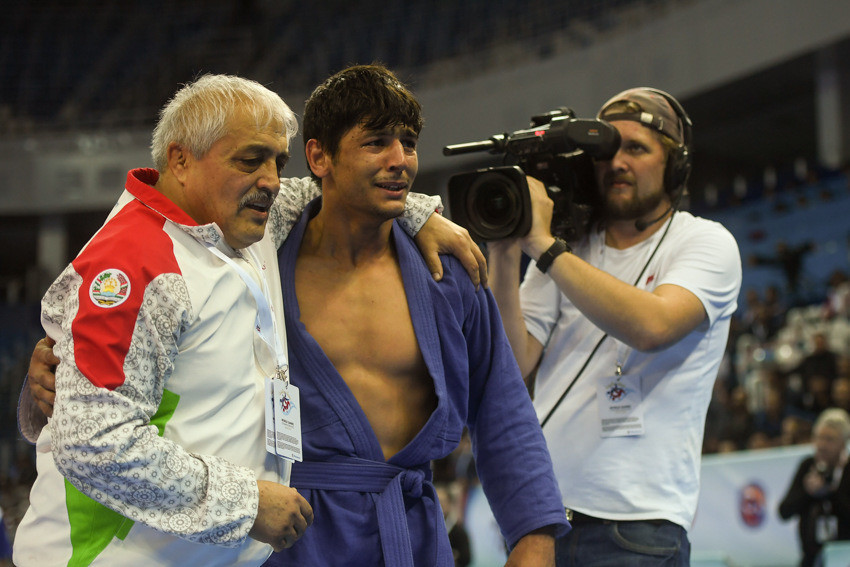 Tajikistan's Behruzi Khojazoda struggled to hold back the tears after beating Belarus' Stsiapan Papou in the men's 74kg final ©FIAS