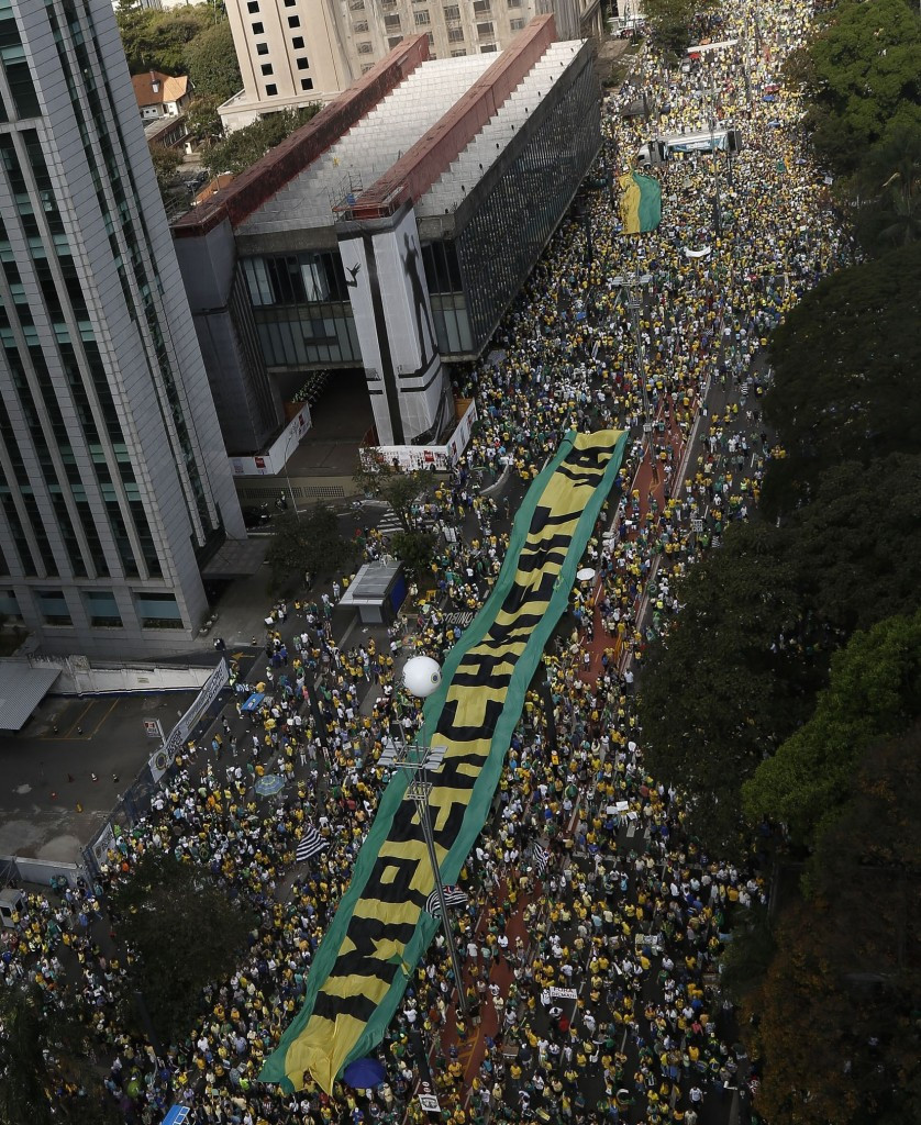 Protesters marching against the Government in Sao Paulo yesterday. Similar eruptions took place in Rio de Janeiro and elsewhere in Brazil ©AFP/Getty Images
