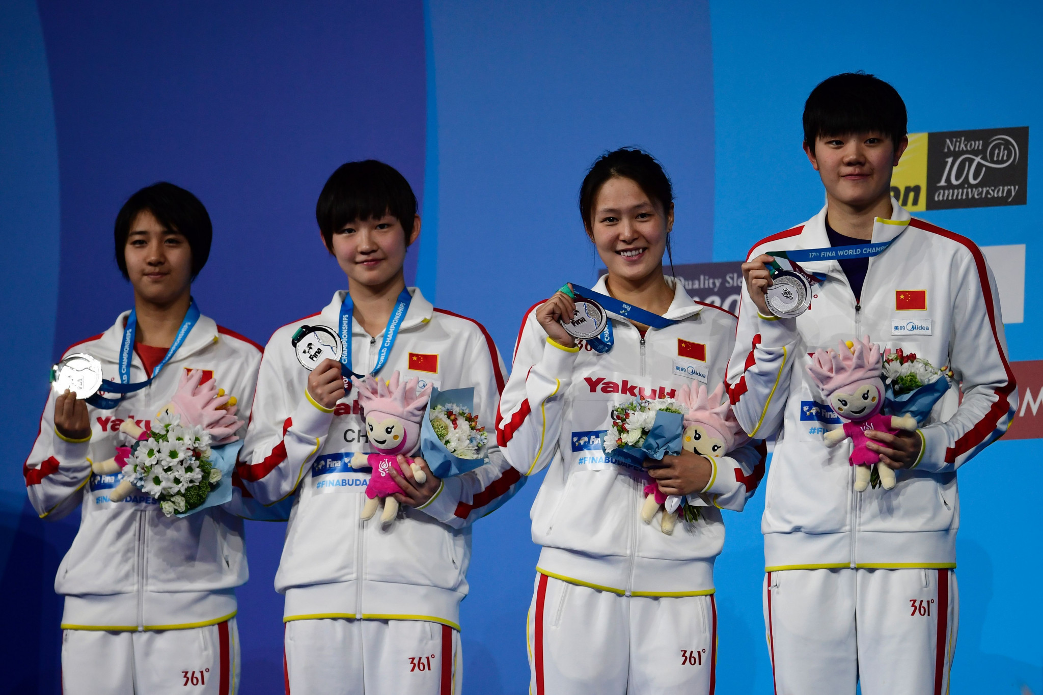 Liu Zixuan, second left, won a silver medal as part of the 4x200m freestyle relay at this year's World Championships in Budapest ©Getty Images