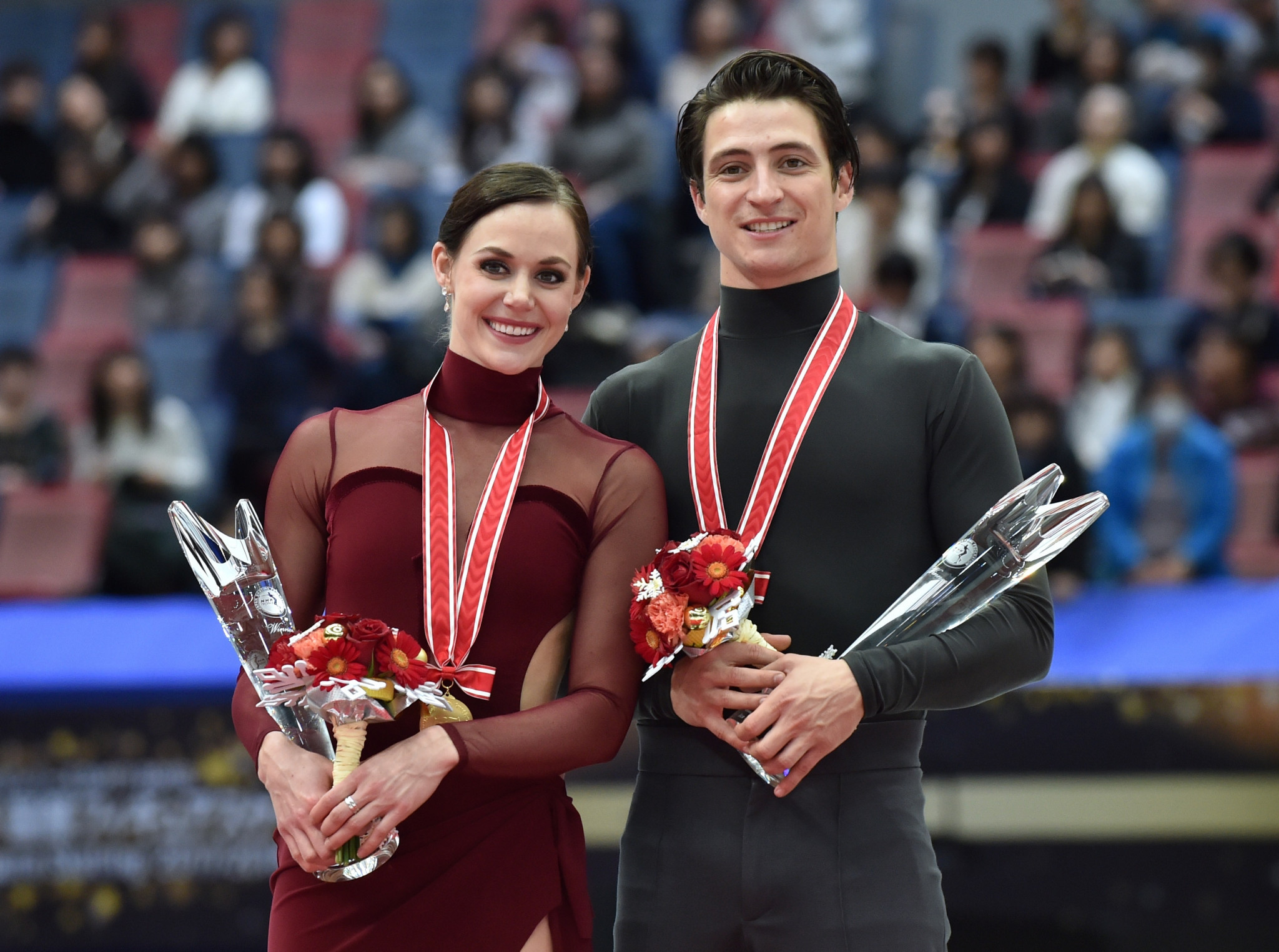 Tessa Virtue and Scott Moir, of Canada, pose on the podium during the awards ceremony for the ice dance free dance event of the Grand Prix of Figure Skating 2017/2018 NHK Trophy in Osaka ©Getty Images