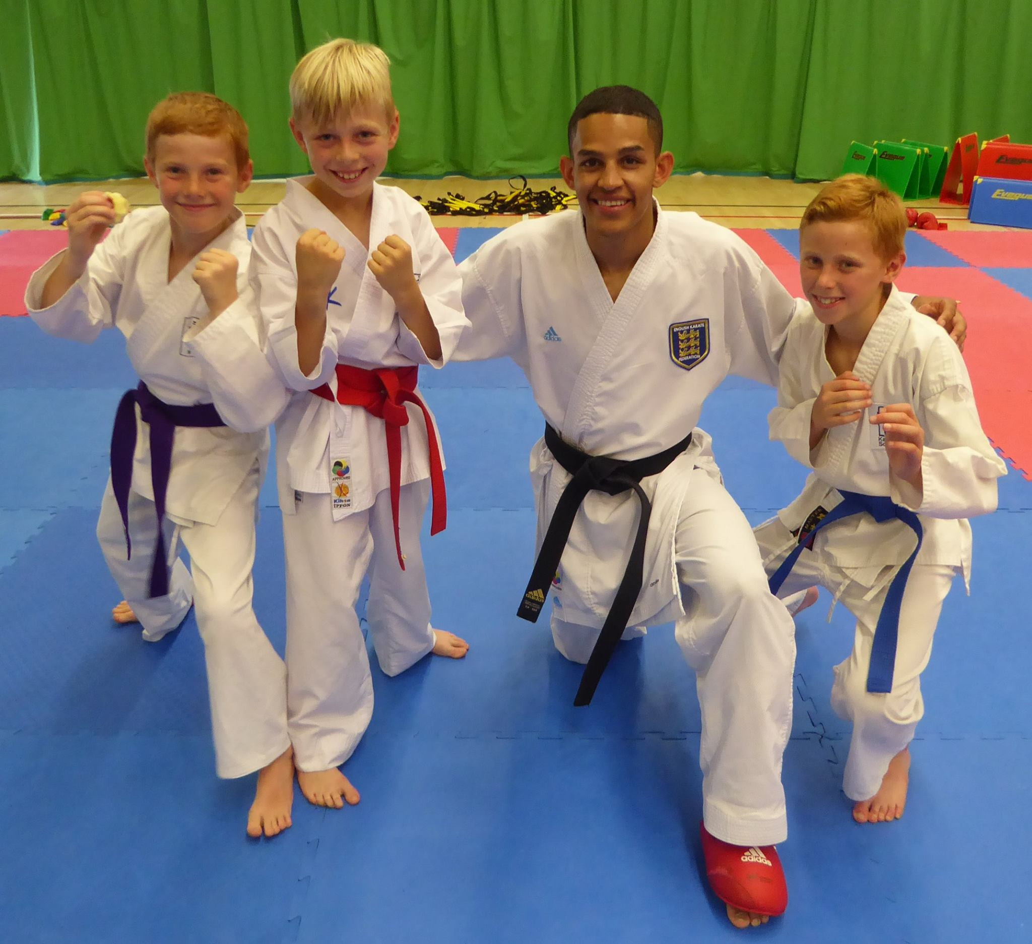 British karate world champion Jordan Thomas is pictured with young students of the game ©Jordan Thomas/Facebook