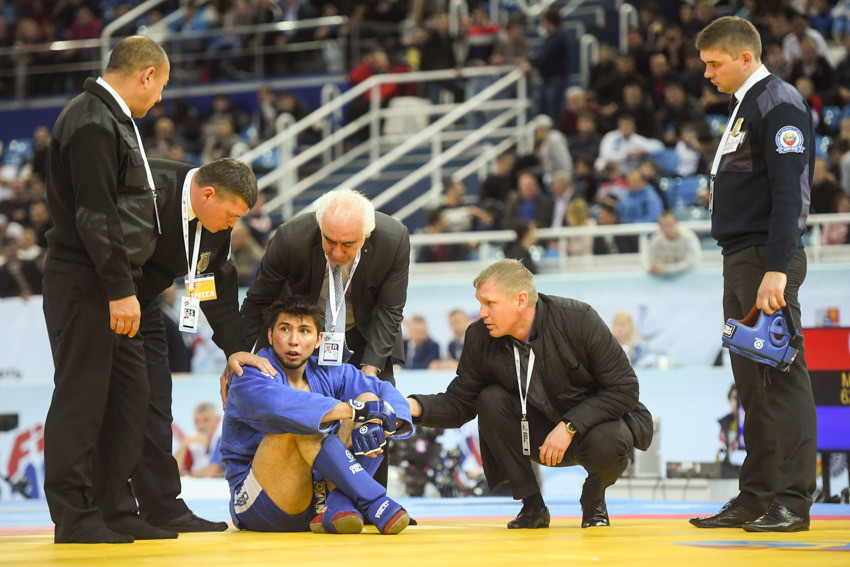 Turkmenistan's Serdar Hojamuhammedov performed a sitting protest after losing his combat men's 90kg semi-final to France's Louis Laurent ©FIAS