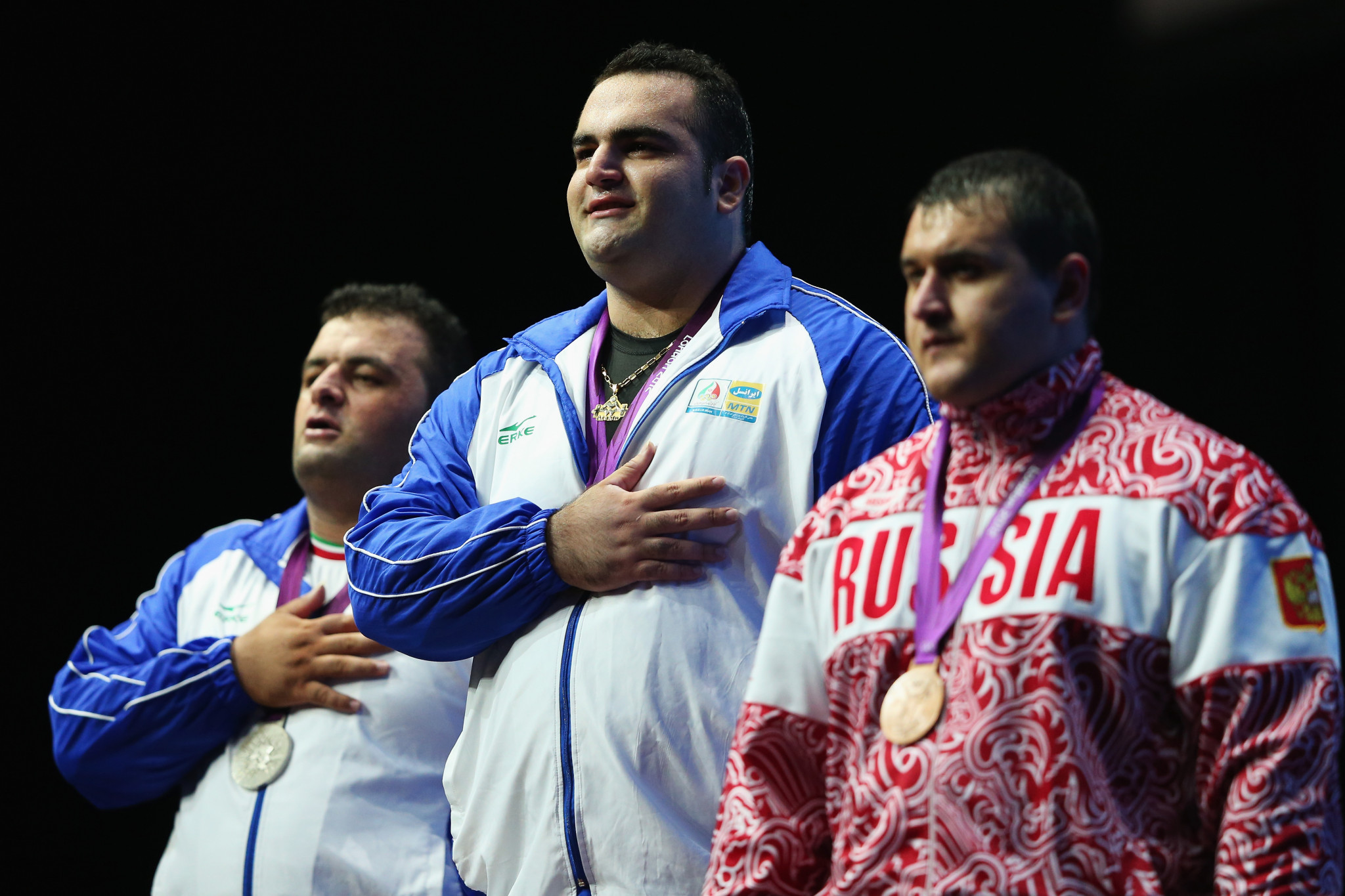 Ruslan Albegov, right, pictured with his two fellow medallists from Iran celebrating Olympic bronze at London 2012 ©Getty Images
