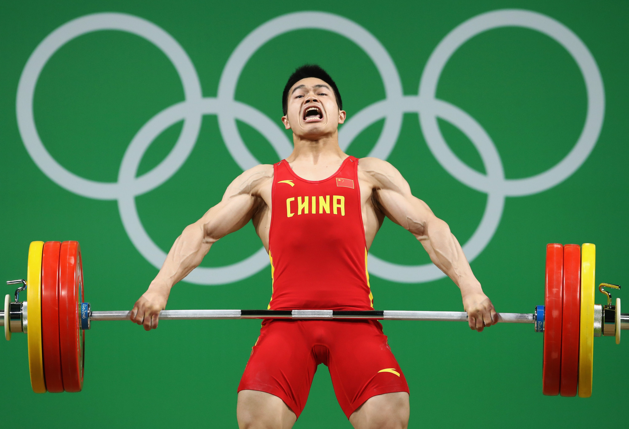 Zhiyong Shi, of China, competes during the men's 69kg Group A weightlifting contest at the Rio 2016 Olympic Games ©Getty Images