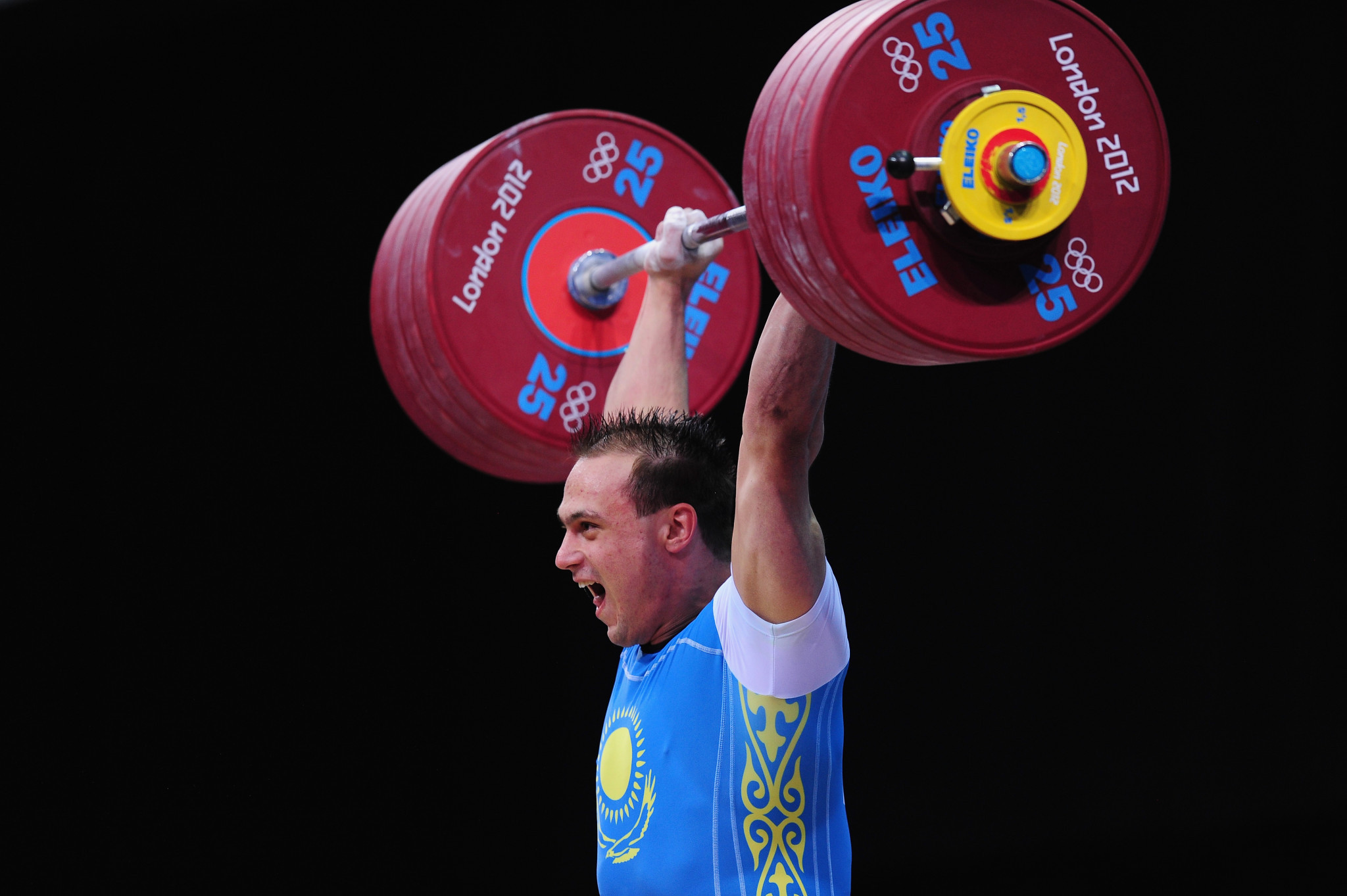 Ilya Ilyin of Kazakhstan sets a new world record and wins the gold medal in the men's 94kg weightlifting final at the London 2012 Olympic Games ©Getty Images