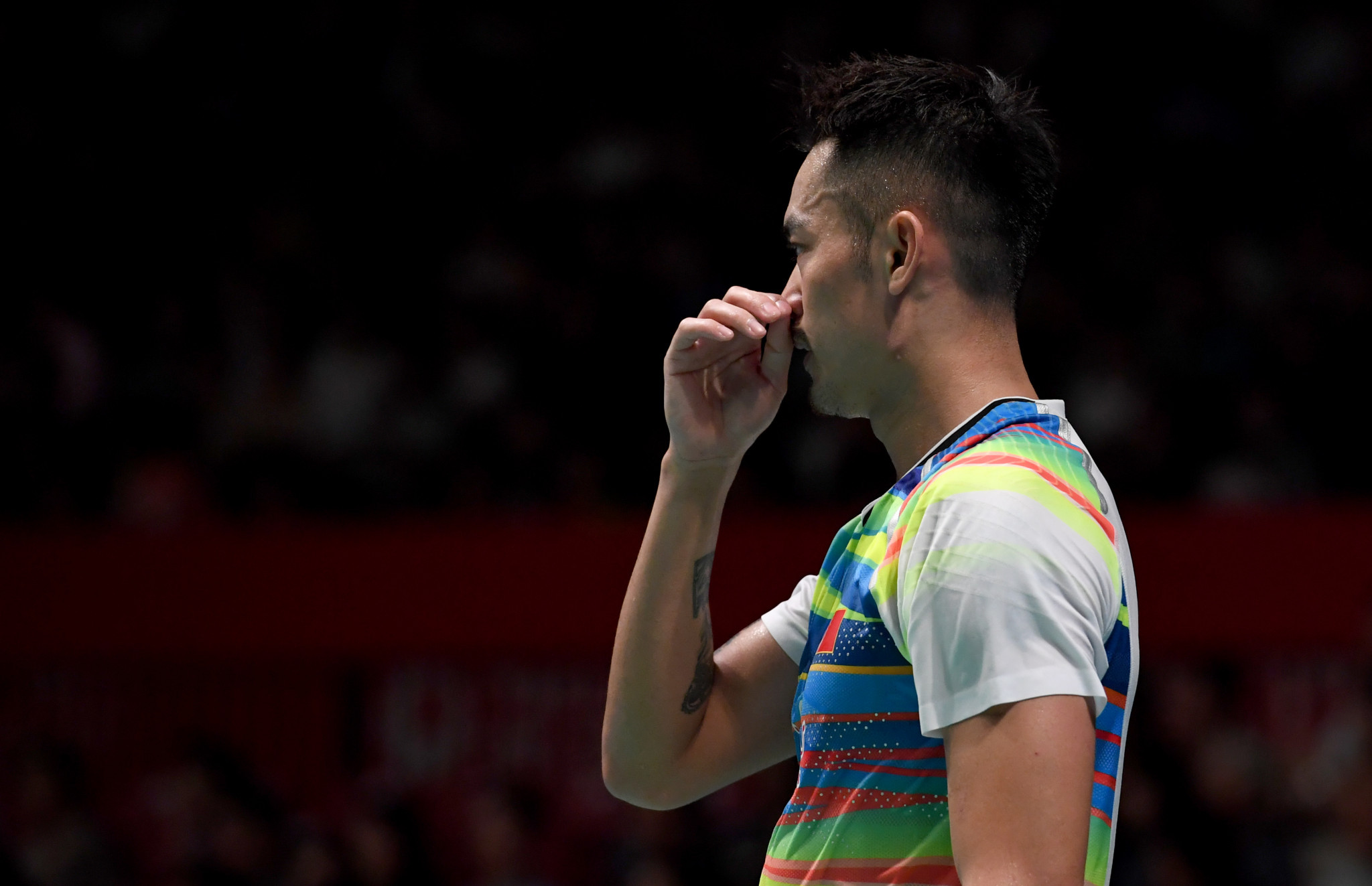 Lin suffers first round defeat at BWF China Open