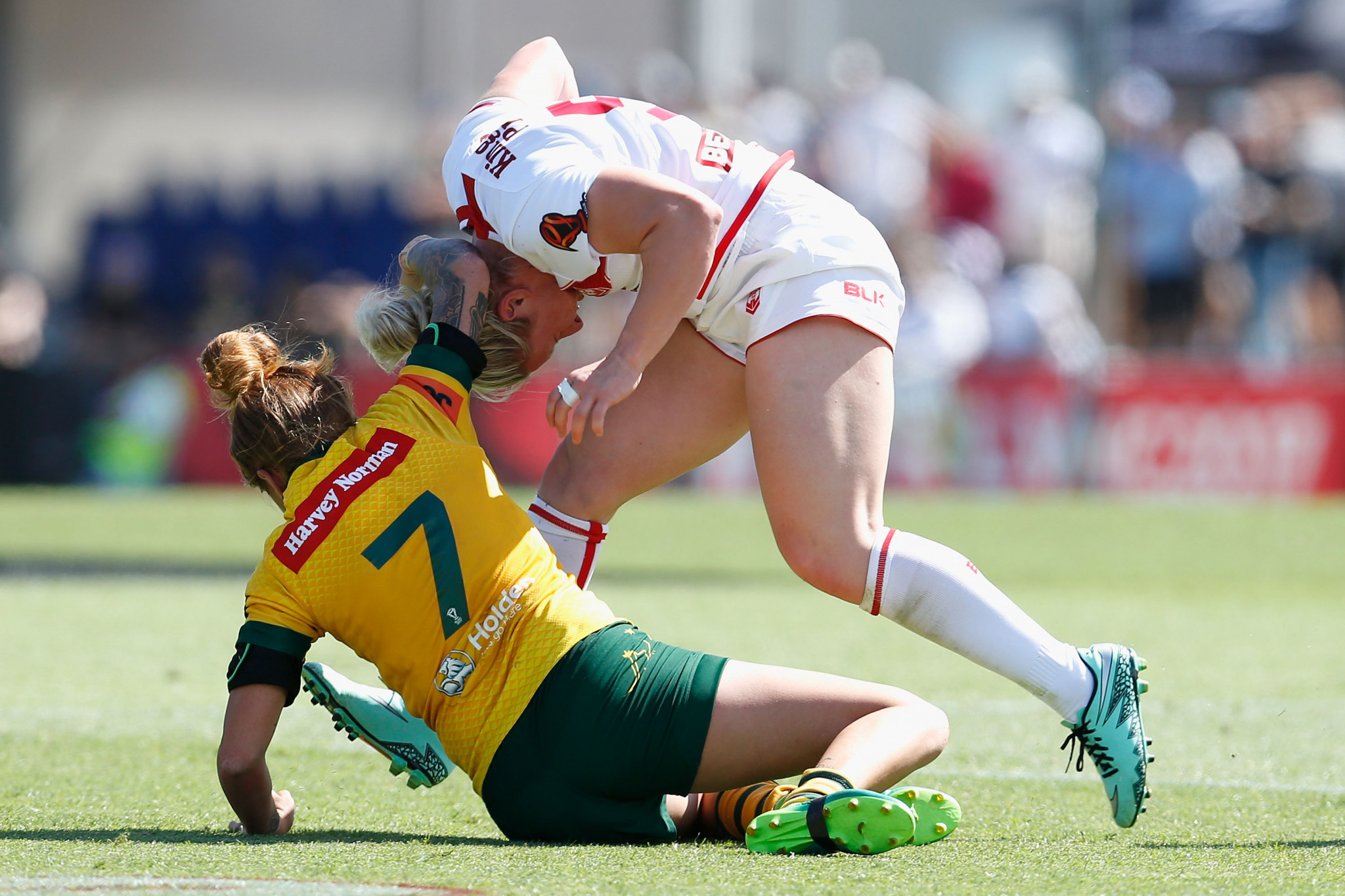 Charlotte Booth of England is tackled by Caitlin Moran of Australia during the 2017 Women's Rugby League World Cup match between Australia and England at Southern Cross Group Stadium ©Getty Images