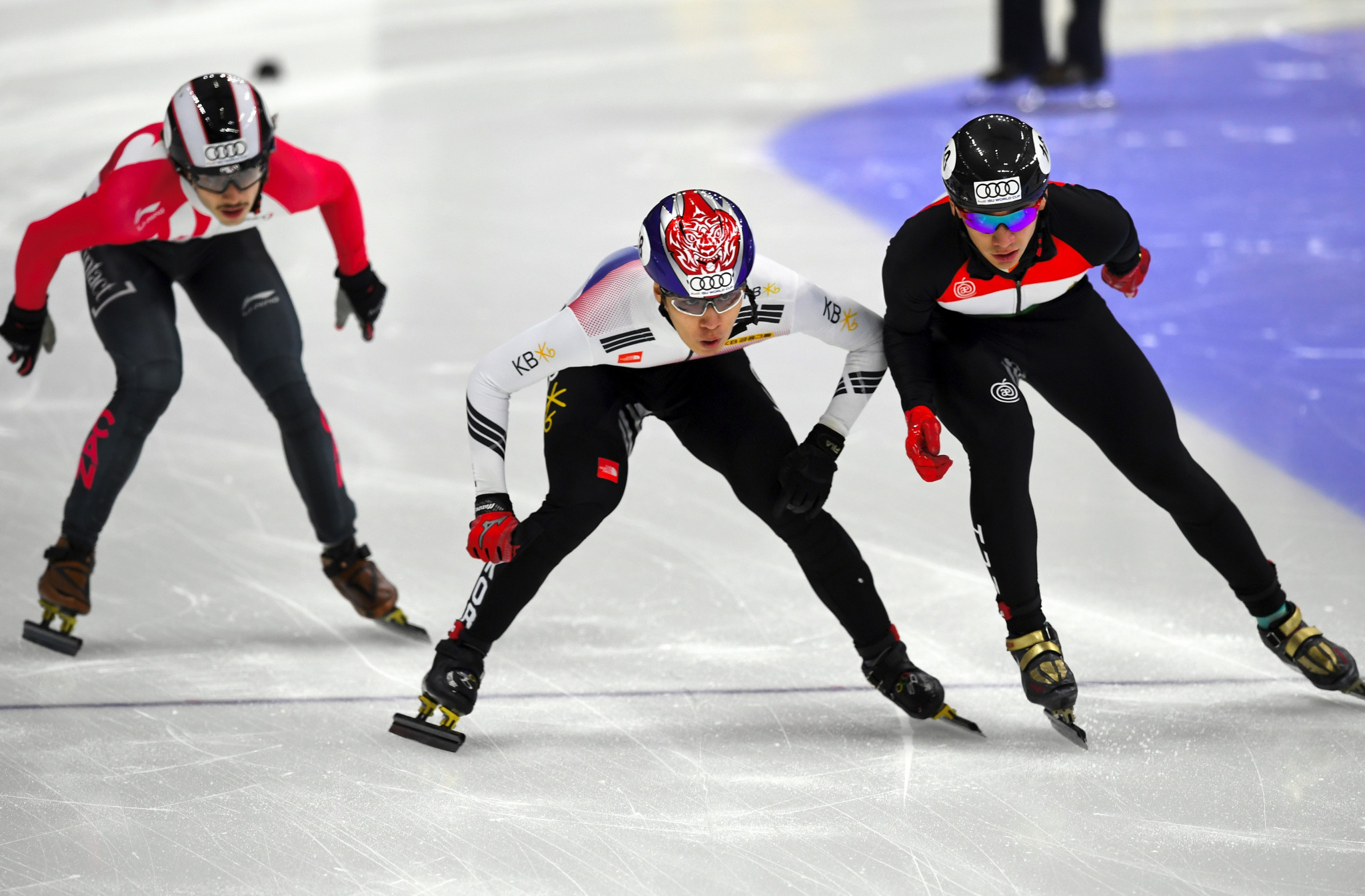 Shaolin Sandor Liu, right, of Hungary and Hwang Dae-Heon, centre, of South Korea compete during the men's 1000 metre final at the ISU World Cup Short Track Speed Skating in Seoul ©Getty Images