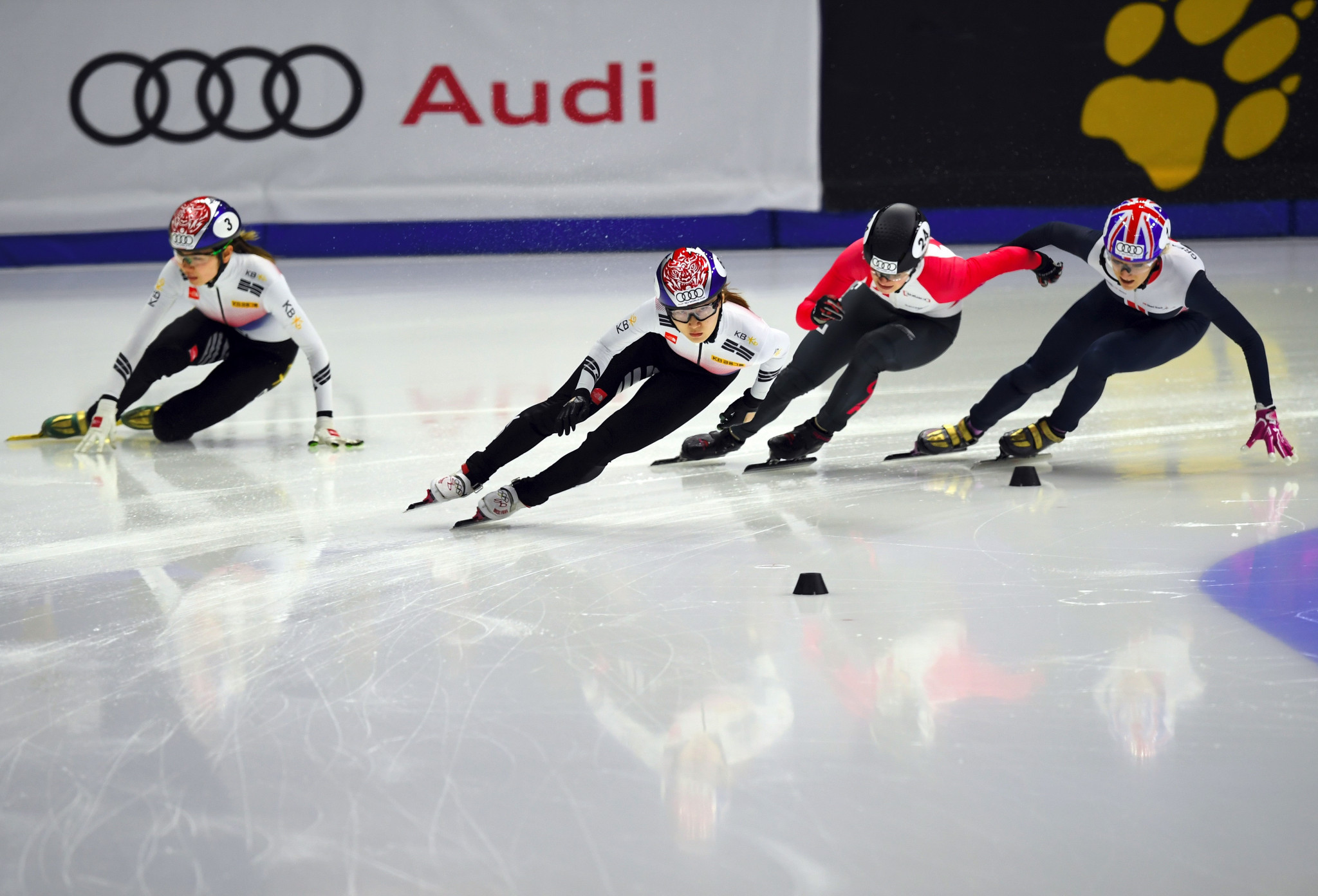 Choi Min-Jeong, second left, of South Korea, Kim Boutin, second right, of Canada and Elise Christie, right, of Great Britain compete as Shim Suk-hee, left, of South Korea falls during the women's 1000 metres at the ISU World Cup Short Track Speed Skating in Seoul ©Getty Images