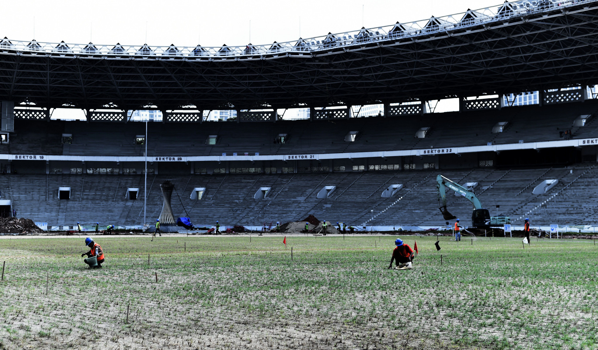 Preparation for the Games is well on track as workers plant new grass at the main stadium for the 2018 Asian Games at the Senayan sport complex in Jakarta ©Getty Images