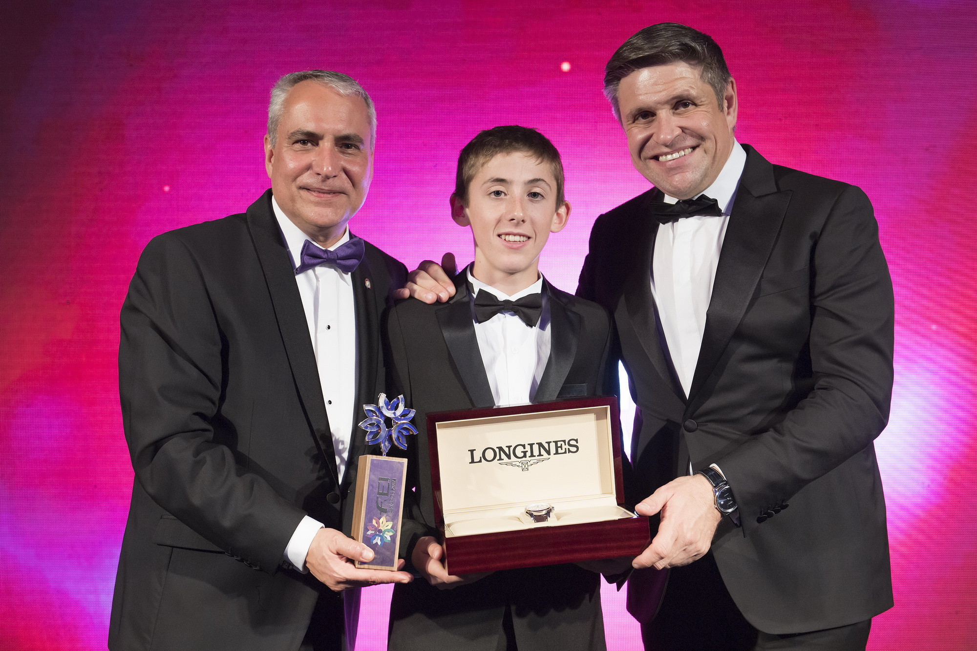 Ireland's Harry Allen, winner of the Longines Rising Star Award, pictured with FEI President Ingmar de Vos, left, and vice- president and head of international marketing Juan-Carlos Capelli at the FEI Awards in Montevideo ©FEI
