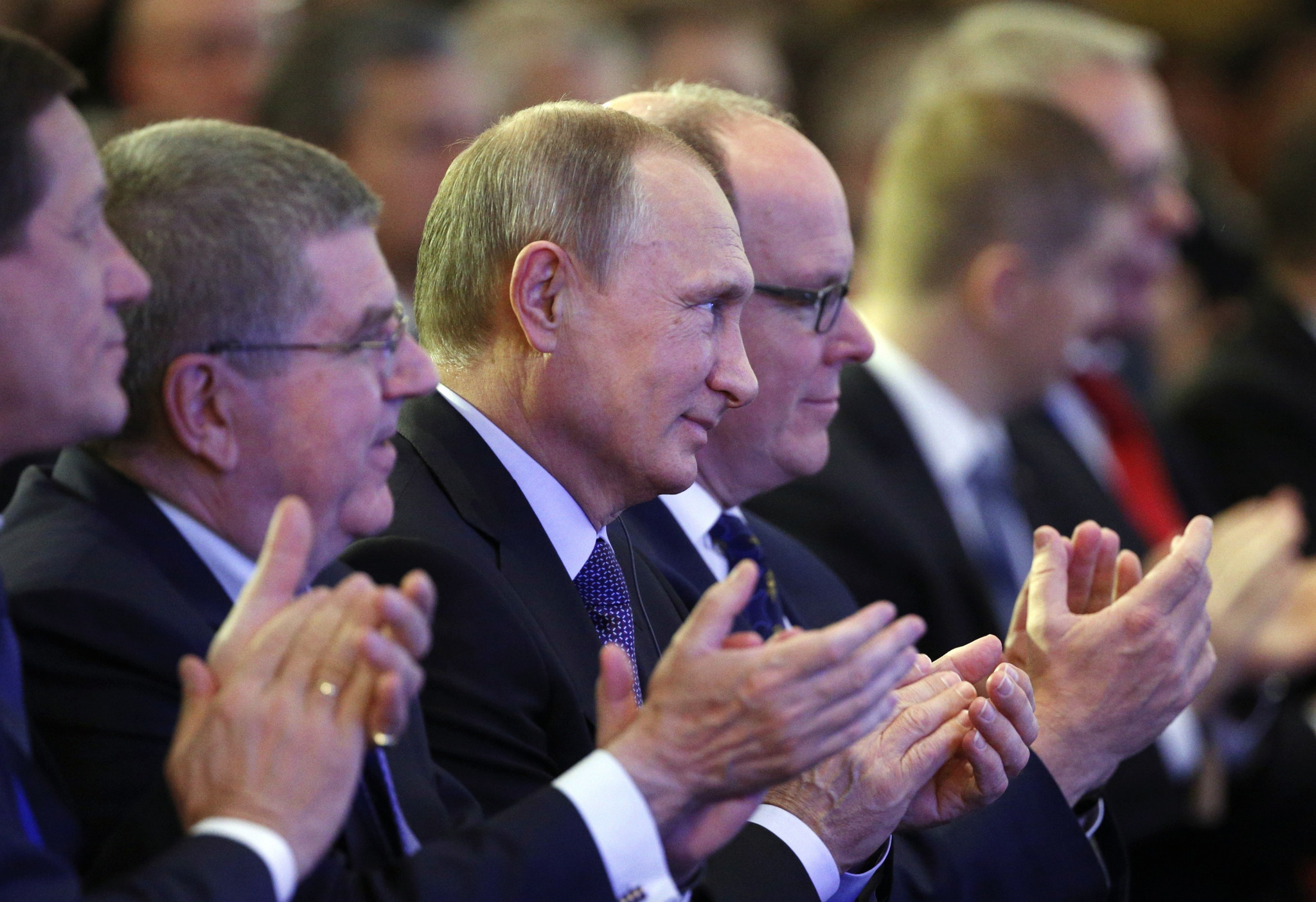 Russian President Vladimir Putin, pictured alongside Thomas Bach and IOC member Prince Albert of Monaco, has claimed the doping scandal involving his country is part of a United States-led conspiracy ©Getty Images