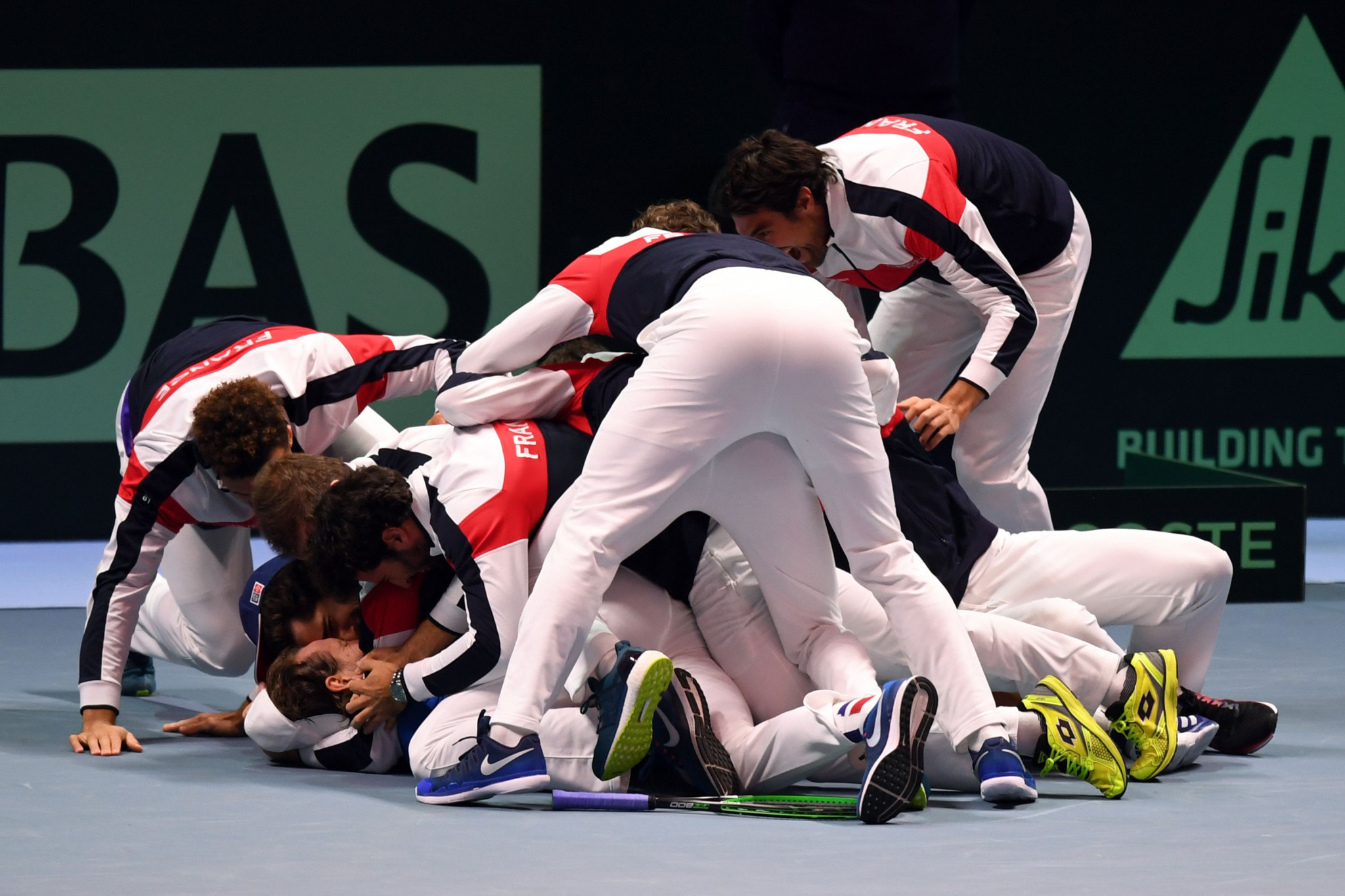A jubilant France team celebrate their first Davis Cup success in 16 years after a thrilling 3-2 victory over Belgium in Lille ©Getty Images