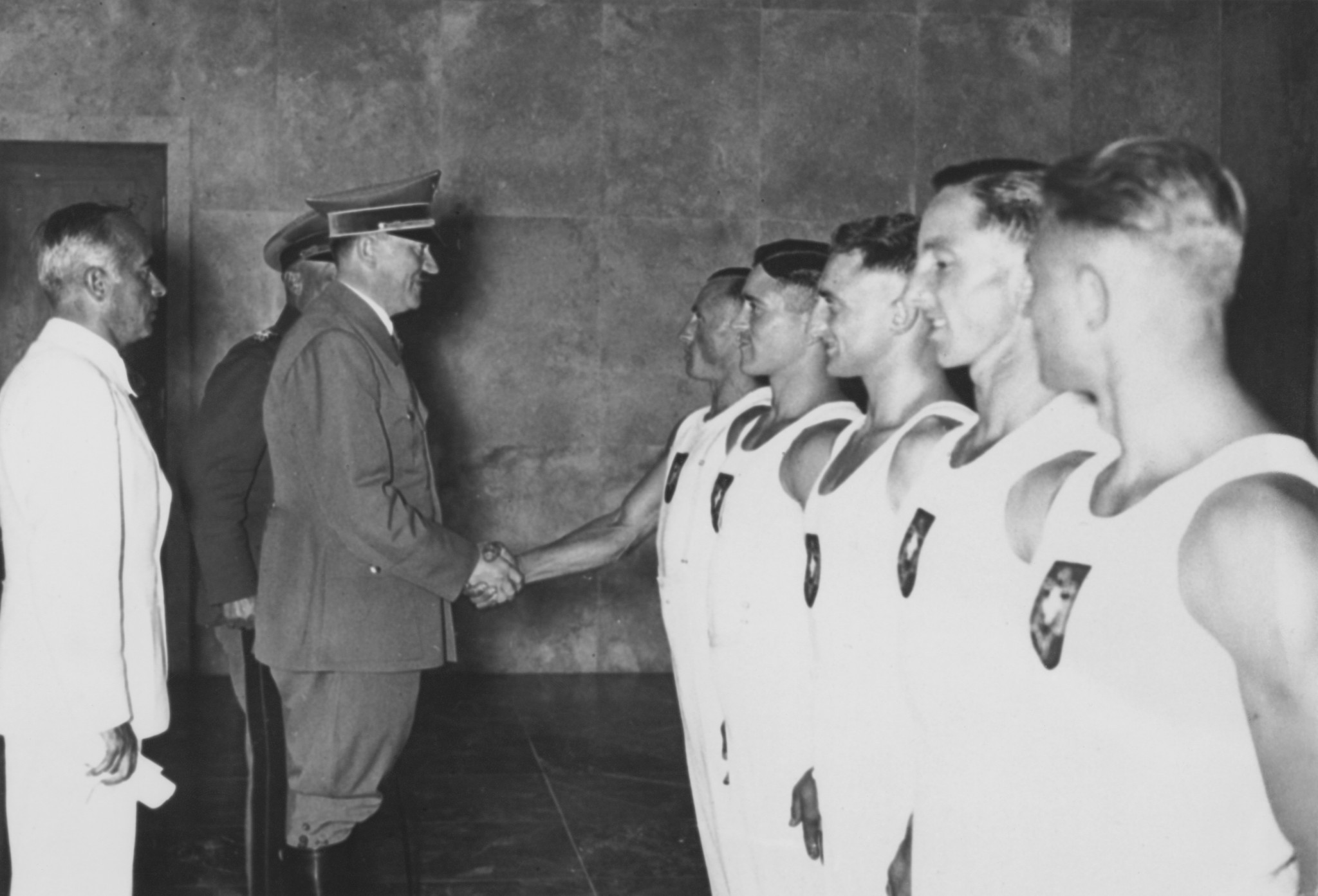 Adolf Hitler shakes hands with British rower Jack Beresford after he and Leslie Frank