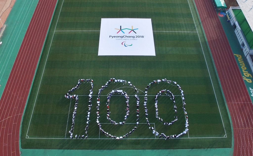 Attendees at the event spelled out 100 to mark the milestone ©Pyeongchang 2018