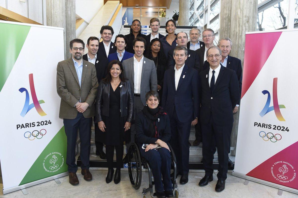 Paris 2024 and IOC figures pose during the IOC Orientation Seminar