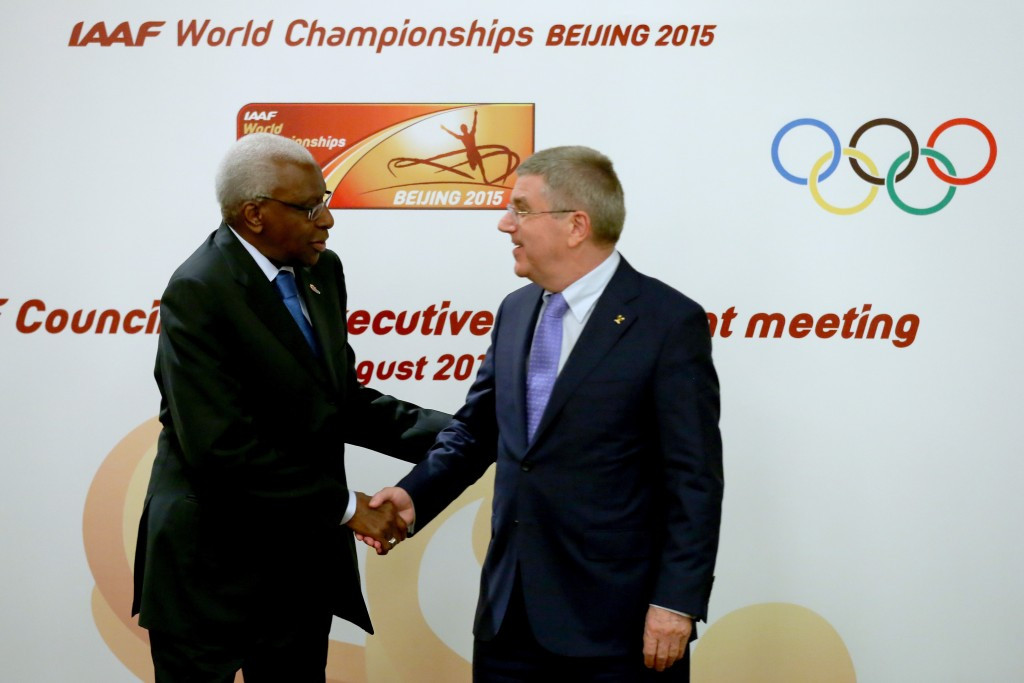 IOC President Thomas Bach (right), pictured with outgoing IAAF President Lamine Diack, said he was emotionally still in favour of life bans for doping, but had accepted it was legally impossible to enforce ©Getty Images