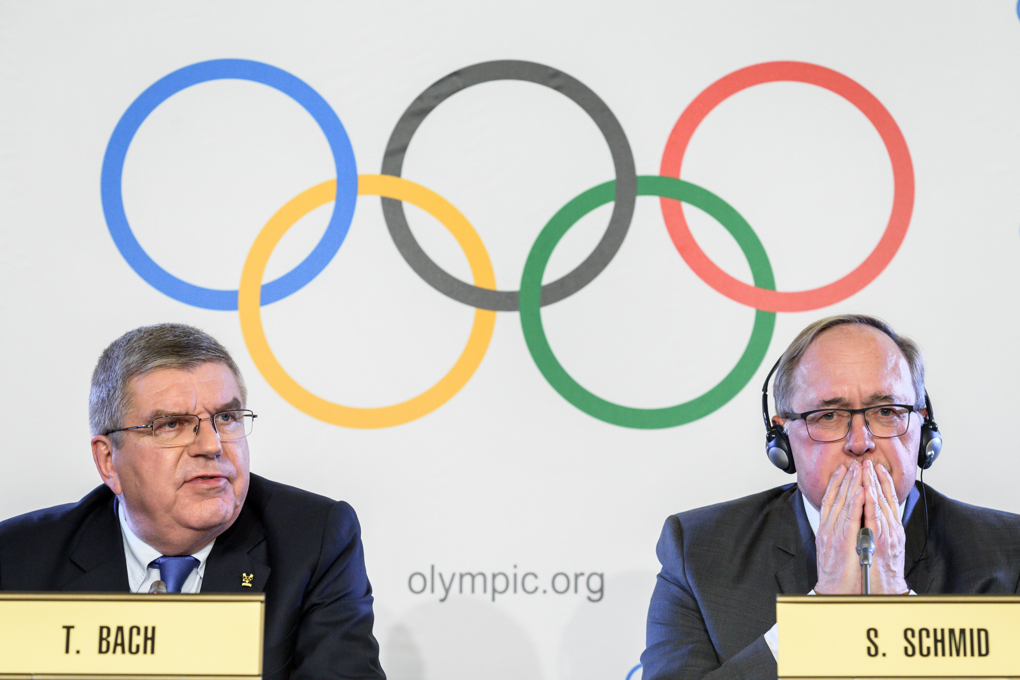 IOC President Thomas Bach, left, alongside Samuel Schmid during the announcement today ©Getty Images