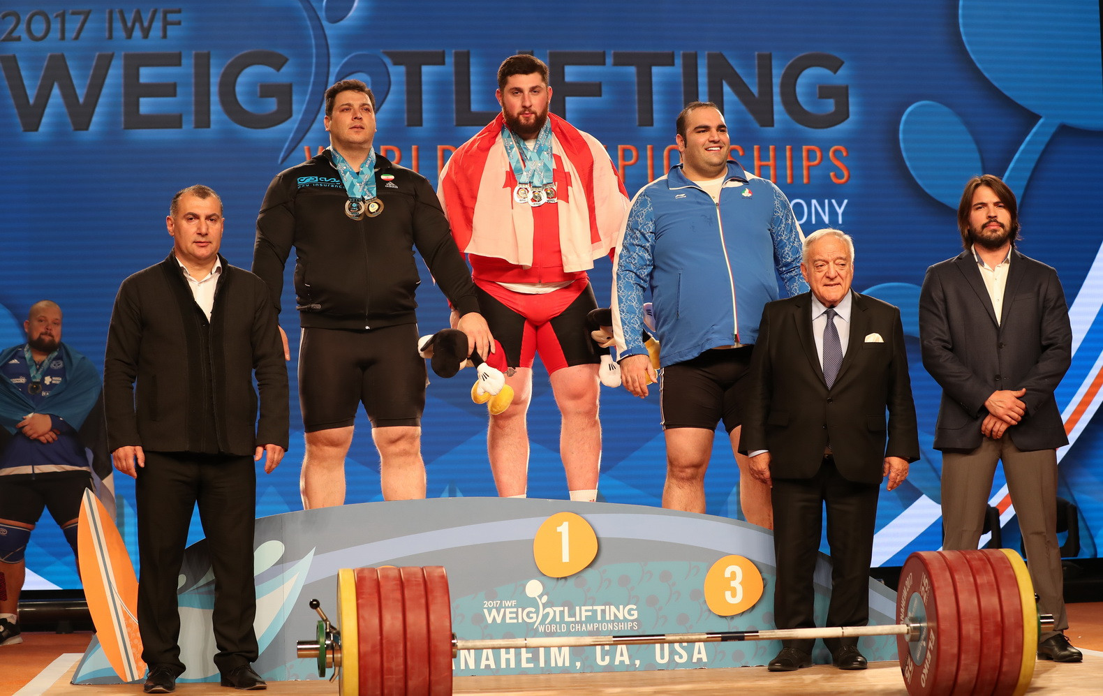 The three medallists celebrate their success ©IWF