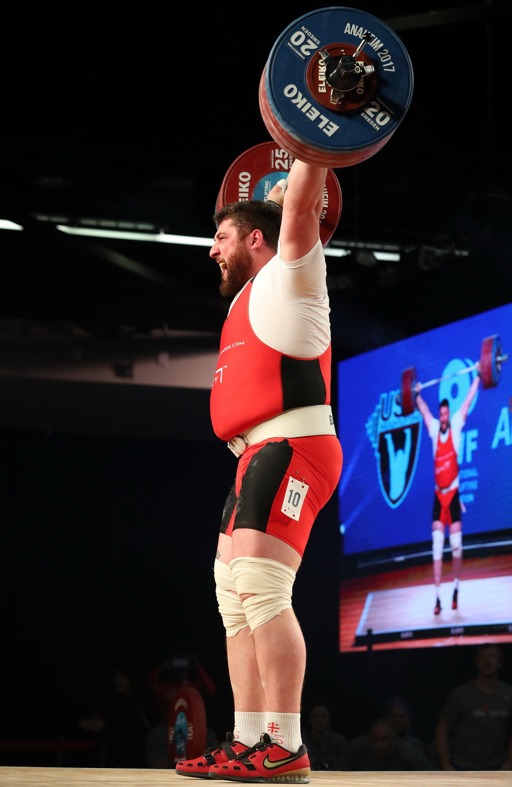 Reigning Olympic champion Lasha Talakhadze broke the men's over 105kg snatch and overall world records on his way to claiming a hat-trick of gold medals today ©IWF