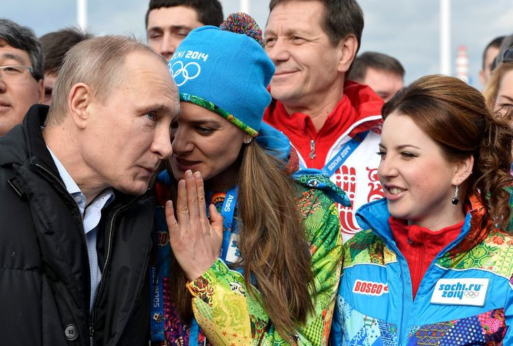 Russian President Vladimir Putin, left, and double Olympic pole vault gold medallist Yelenva Isinbayeva, centre, both believe athletes from the country should compete under a neutral flag at Pyeongchang 2018 ©Getty Images