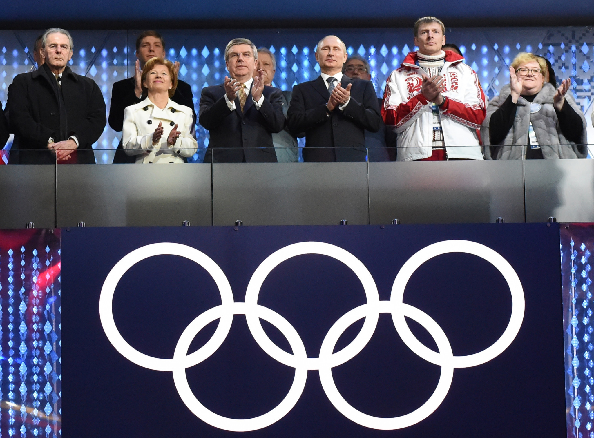 Alexander Zubkov, second right, alongside Russian President Vladimir Putin at the Closing Ceremony of Sochi 2014 ©Getty Images