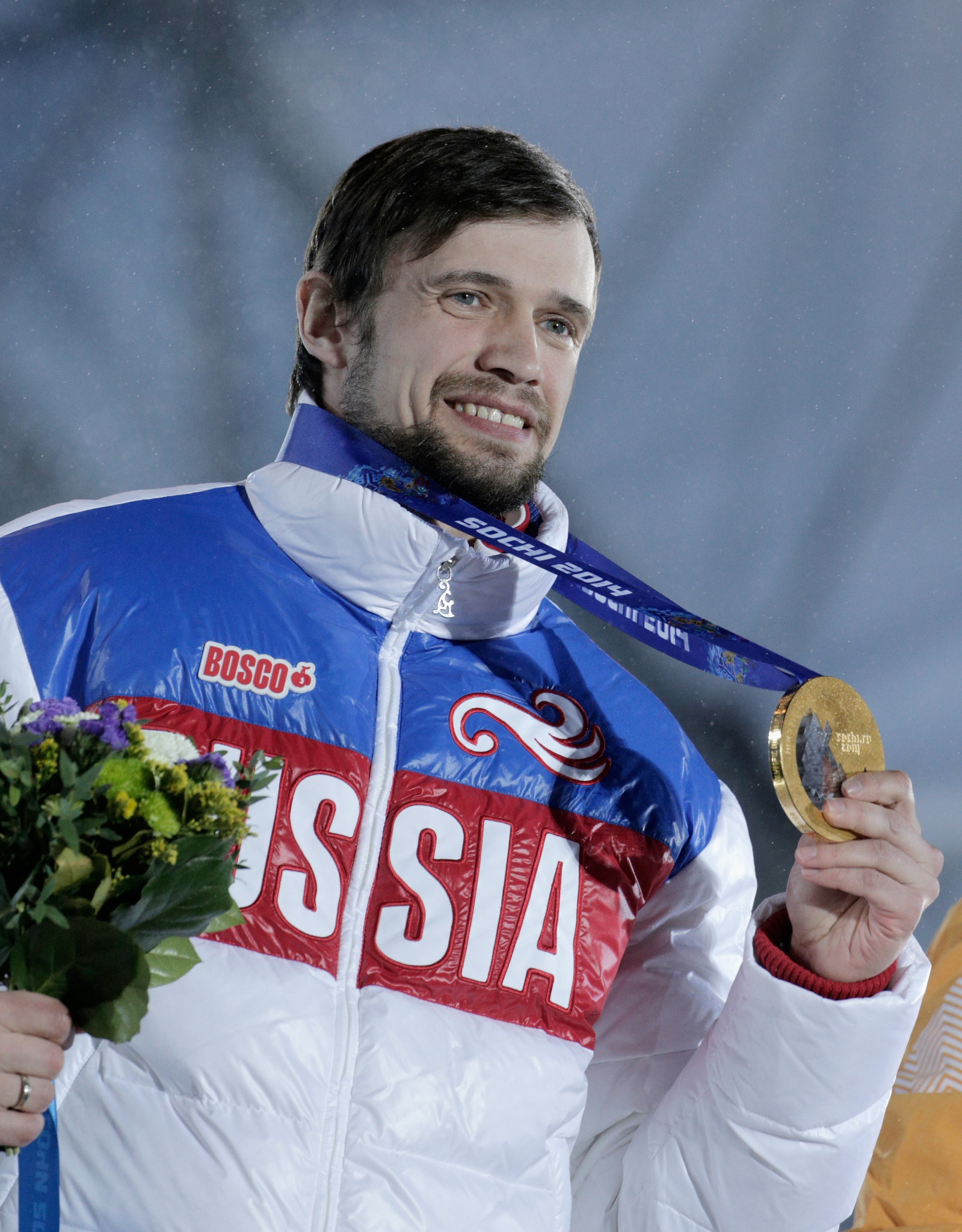 Aleksandr Tretiakov pictured with his men's skeleton medal at Sochi 2014 ©Getty Images