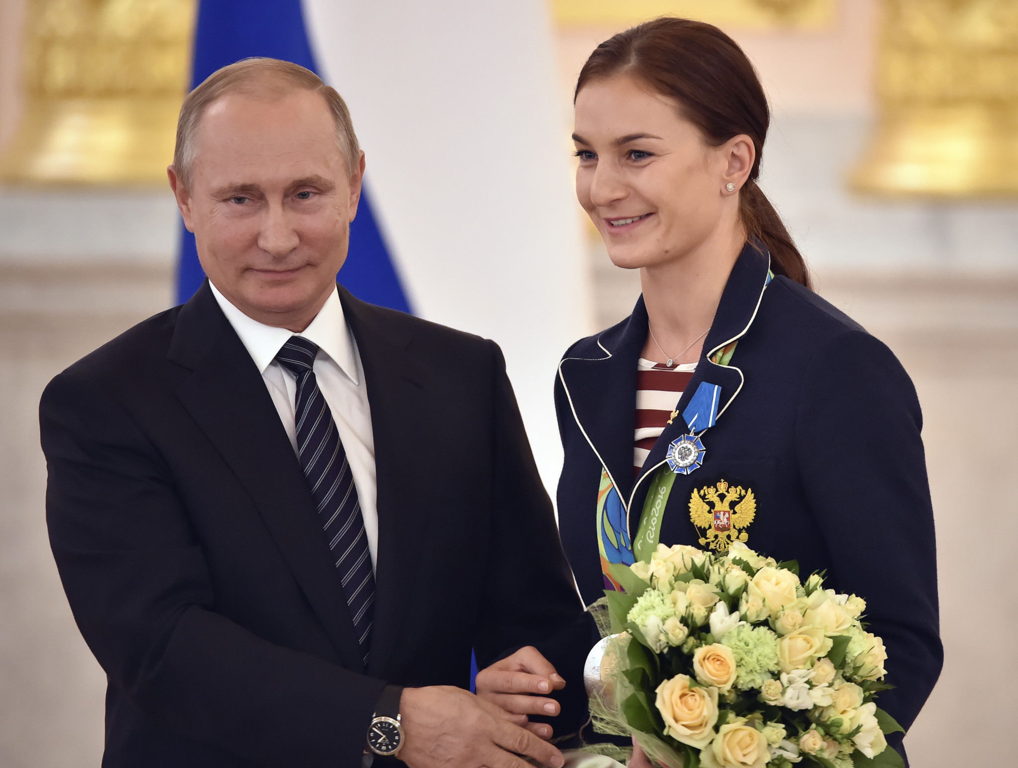 Sofya Velikaya, seen here with Vladimir Putin, says that all Russian athletes have announced plans to complete as neutral athletes under the Olympic flag at next year's Winter Olympic's in Pyeongchang ©Getty Images