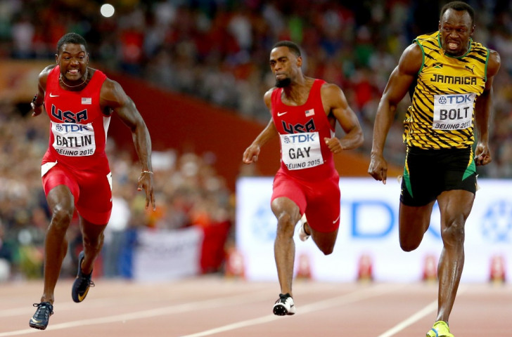 Usain Bolt (right) retains his world 100m title in what he called his 'hardest race' as he finishes in 9.79sec ahead of silver medallist Justin Gatlin, the fastest this year, who clocked 9.80 ©Getty Images